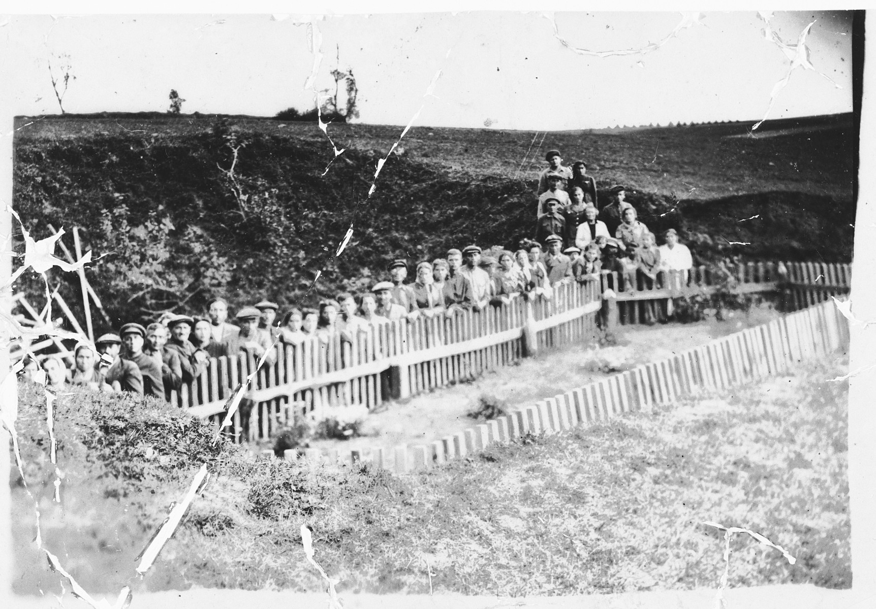 Members of the Bielski partisan group stands by the site of a mass grave shortly after liberation.