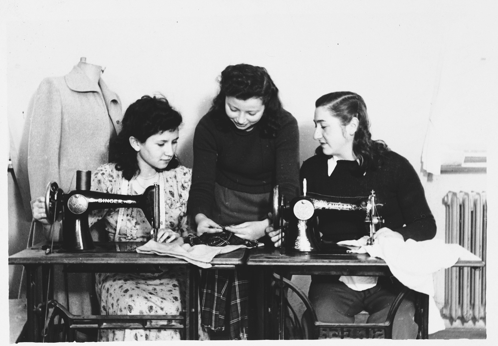 Young women learn to sew in an ORT school in the Foehrenwald displaced persons camp.