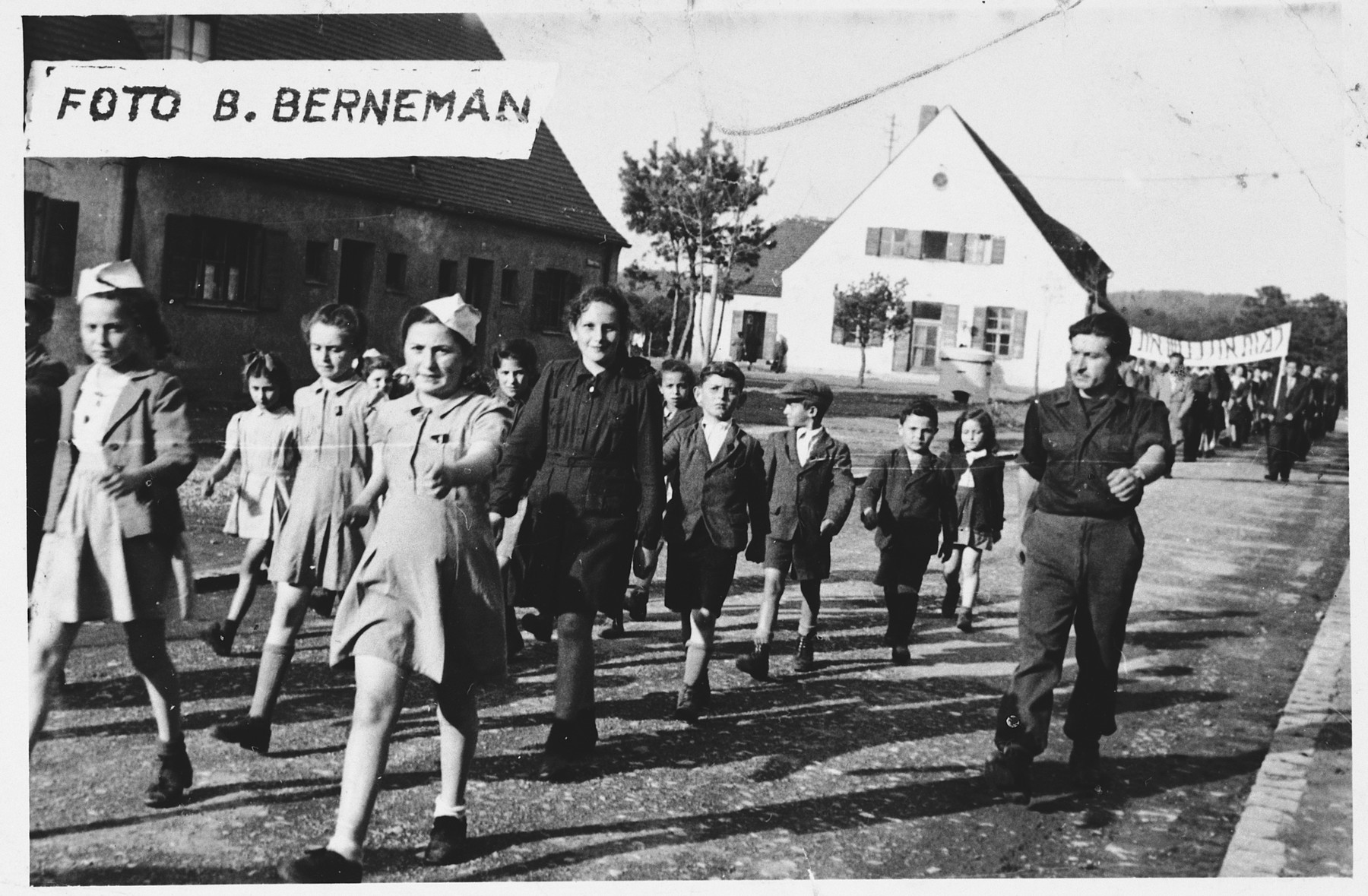 Children in the Foehrenwald displaced persons camp march in a Zionist parade.  Among those pictured is Sonia Dzienciolski.