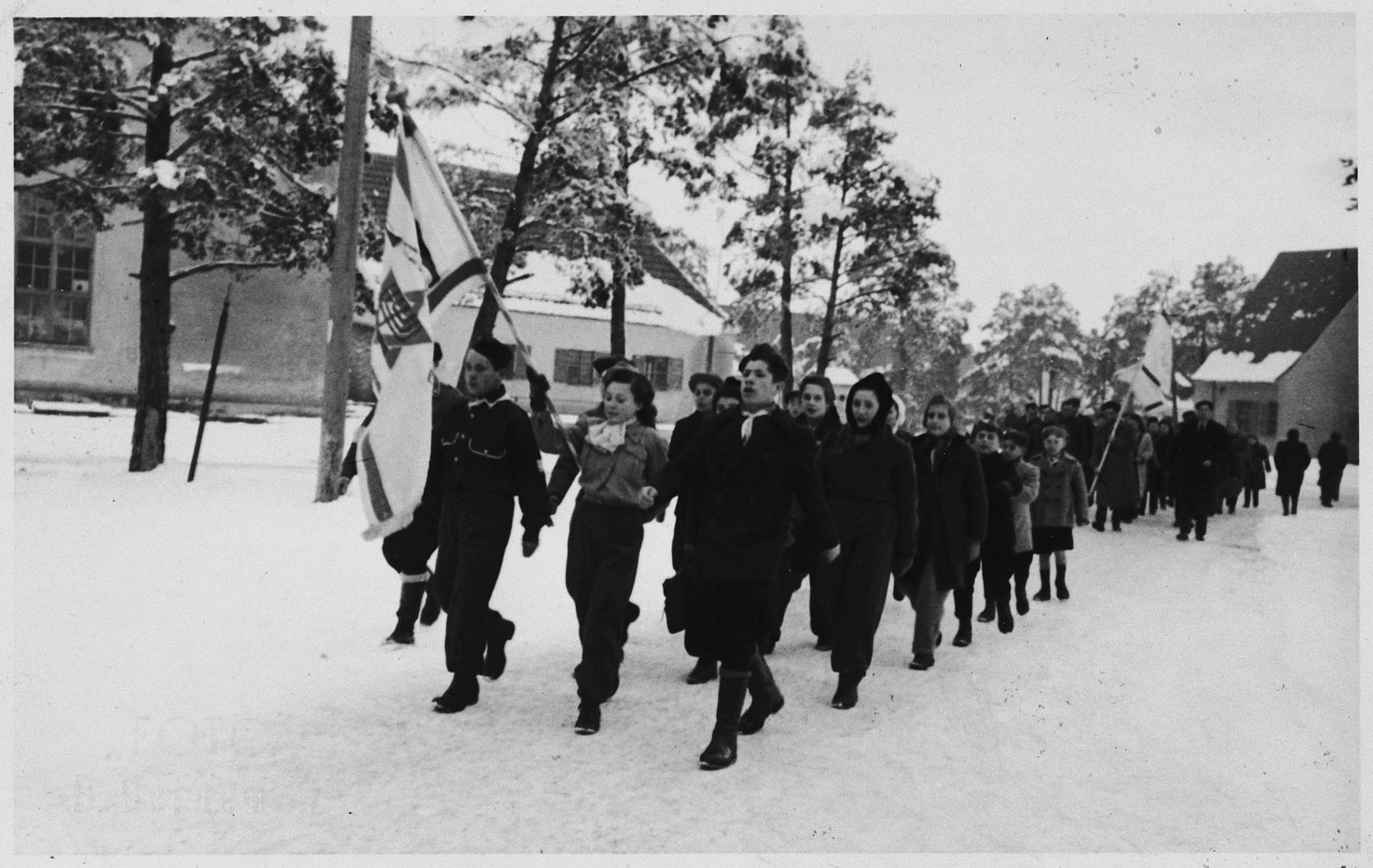 Zionist youth march with an Israeli flag in the Foehrenwald displaced persons camp.