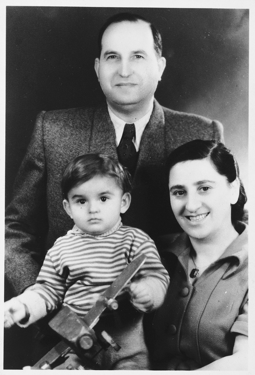 Studio portrait of the Pleszowski family.  Pictured are Jezhik, Felicja and Adam Pleszowski.