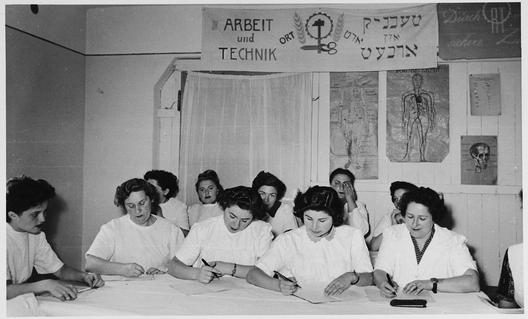 Women learn to become beauticians in an ORT school in the Foehrenwald displaced persons camp.