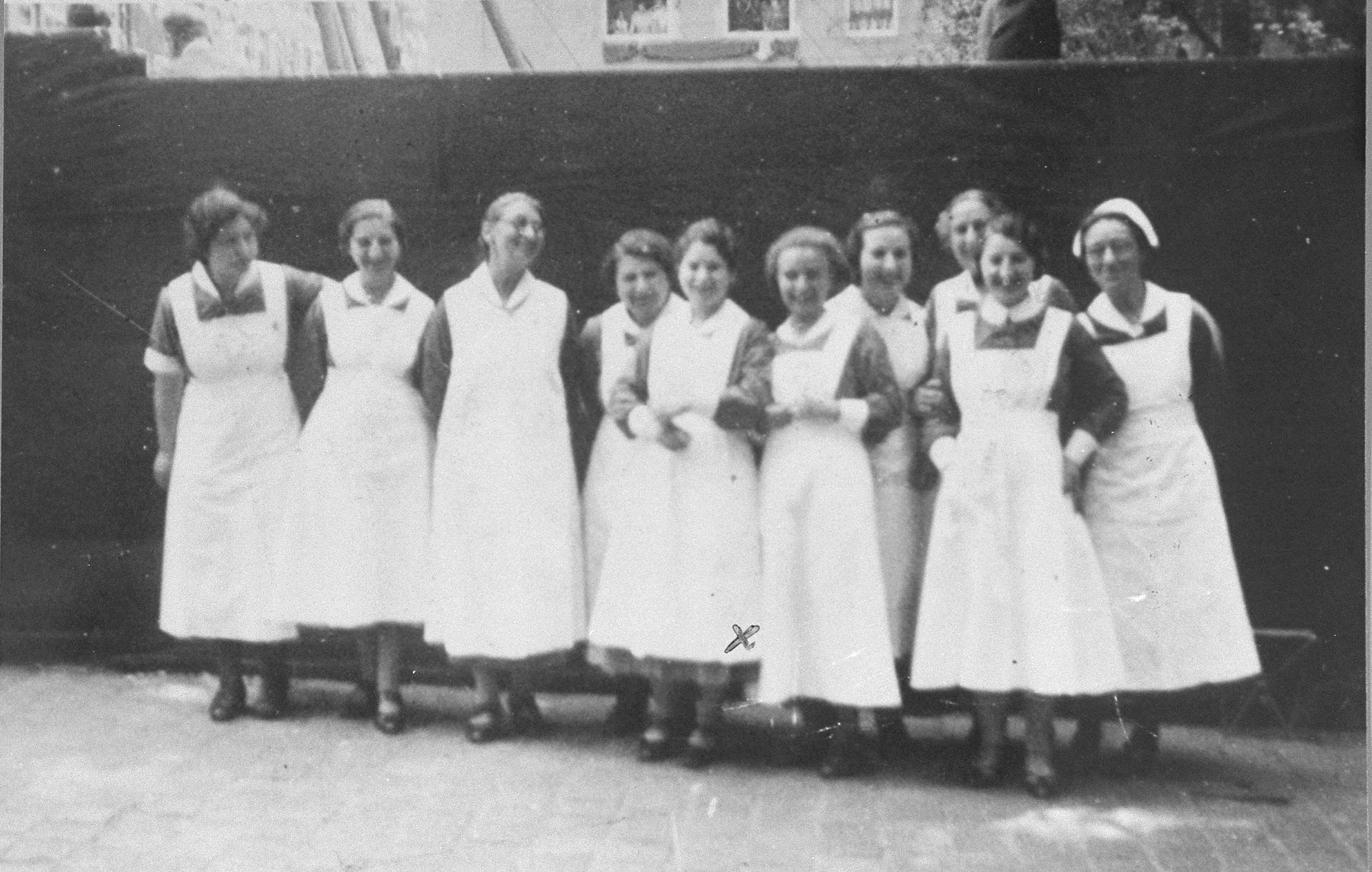Nurses at the Jewish Invalid Hospital in the Jewish quarter of Amsterdam.  Elisabeth Rood is pictured fifth from the left.