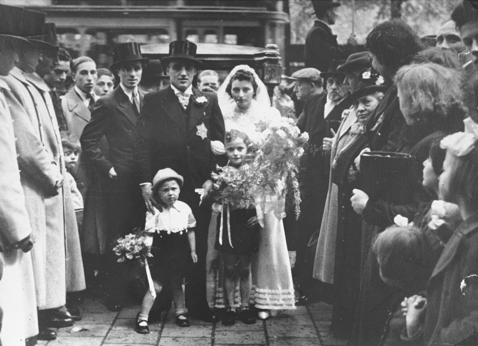 The wedding of Salomon Schrijver and  Flora Mendels in the Jewish quarter of Amsterdam.    Salomon Schrijver (the donor's first cousin) and his wife were deported to Westerbork, and from there, to Sobibor, where they were killed on July 9, 1943.
