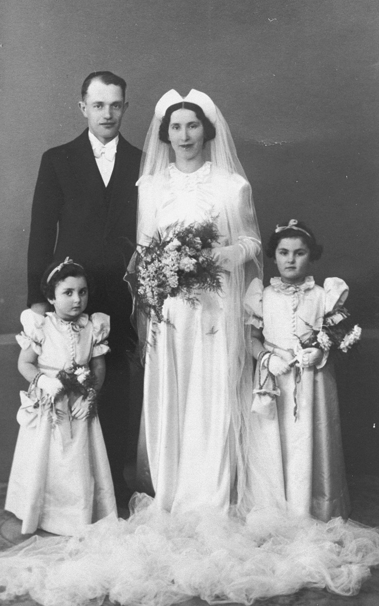 Sarah and Naftali Berger, with their nieces Betty Rich and Margot Baum, shortly after the couple's wedding ceremony.