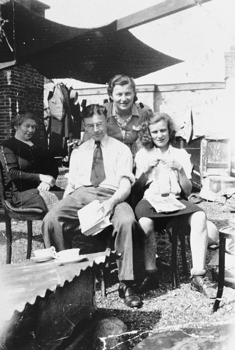 Members of the Wijnberg family sit on the roof of their apartment house during the period in which they were prohibited by Nazi decree from going out into the garden.    Pictured from left to right are Alida, Mauritis, Selma and Betje (Jakobs) Wijnberg.