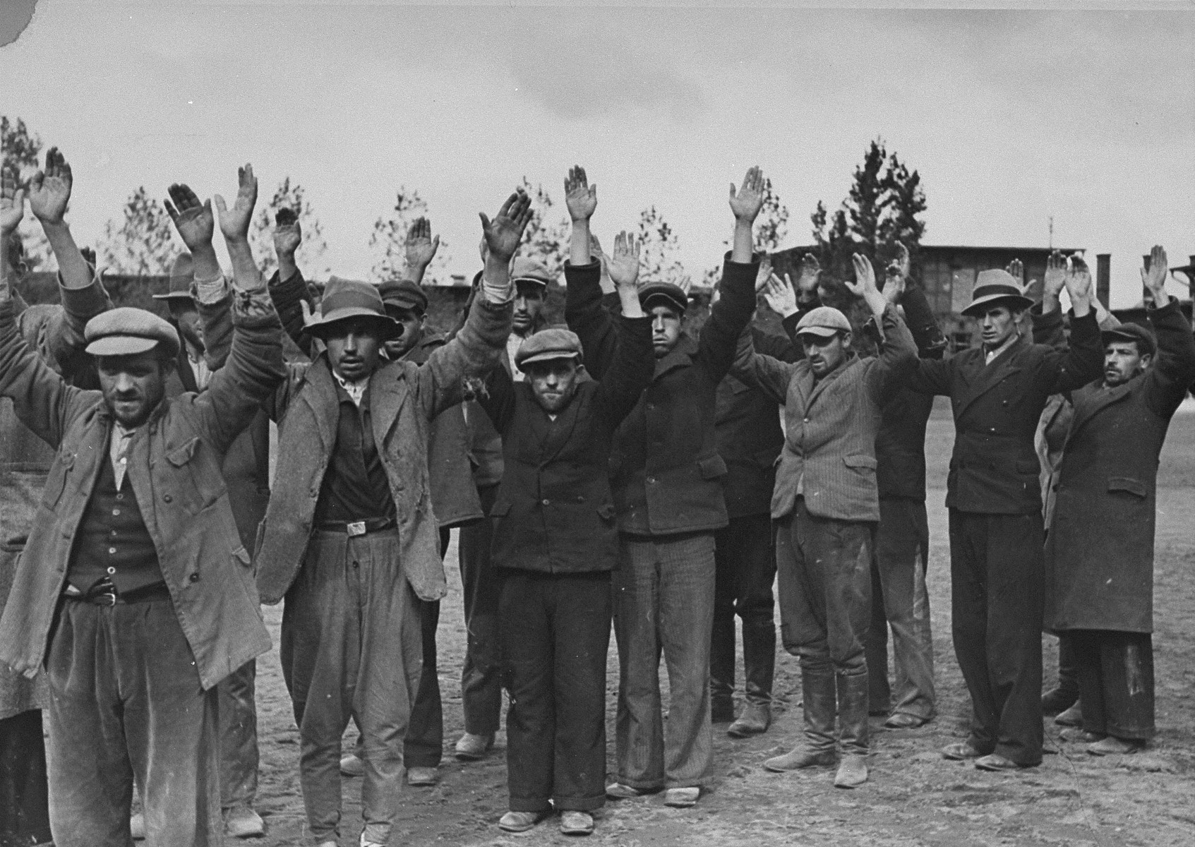 Polish and Jewish inhabitants of Aleksandrow Kujawski hold their arms in the air after their arrest by German soldiers during the conquest of Poland.    These men may have been arrested as hostages to deter civilian attacks on German soldiers.  Should such an attack have occurred in the area, these men would have been shot.  This was standard operating procedure for the German army from the very first days of the war.