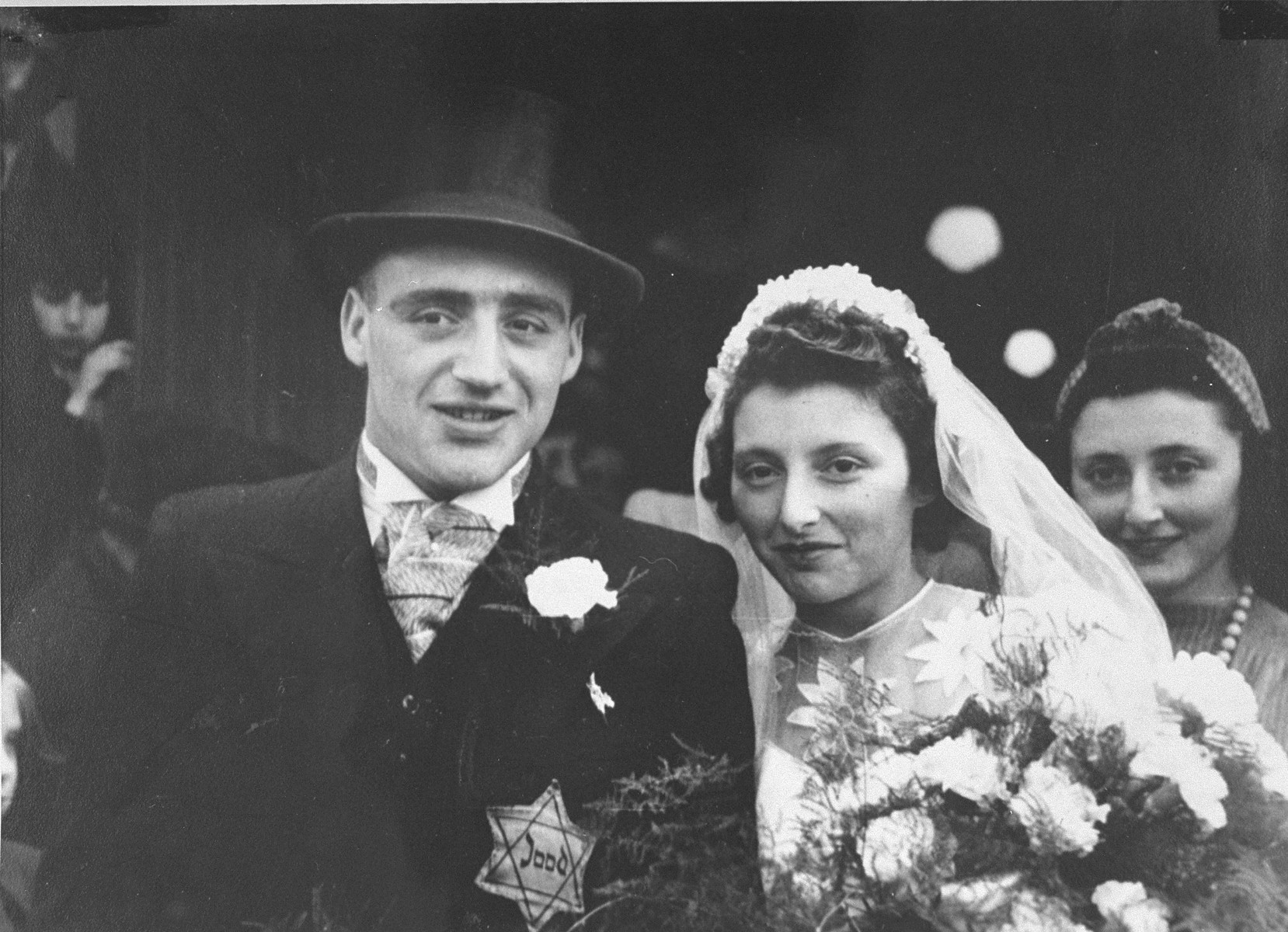 Wedding portrait of Salomon Schrijver and his bride who were married in the Jewish quarter of Amsterdam.    Salomon Schrijver (the donor's first cousin) and his wife were deported to Westerbork, and from there, to Sobibor, where they were killed on July 9, 1943.