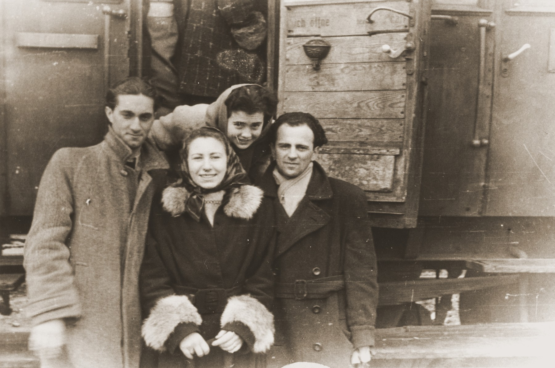 Alicja Fajnsztejn poses with a group of friends before their departure by train to Bremen.  From left to right are Mark Finkel, Alicja Fajnsztejn and Abramovich.  Irene Kane is in the back.