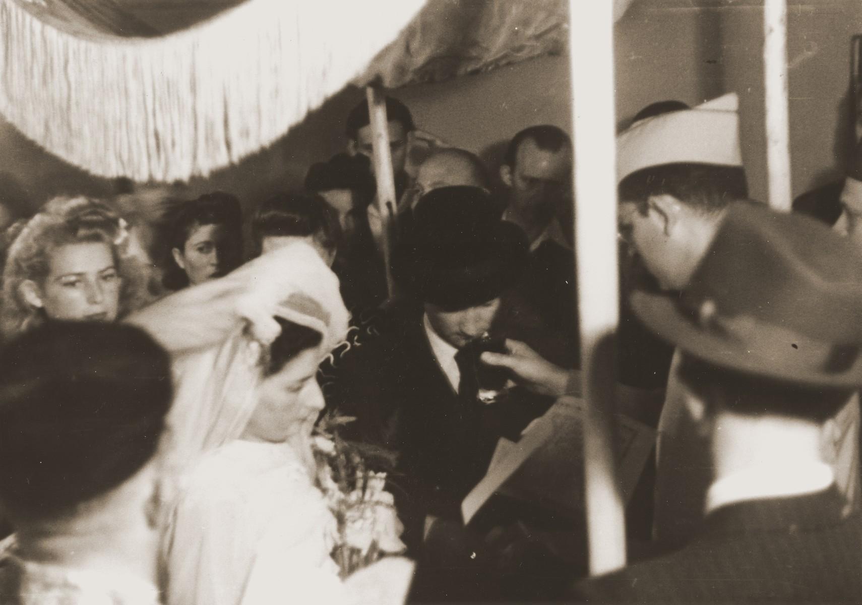 Rabbi Herbert Friedman conducts a wedding at the Berlin chaplain's center.