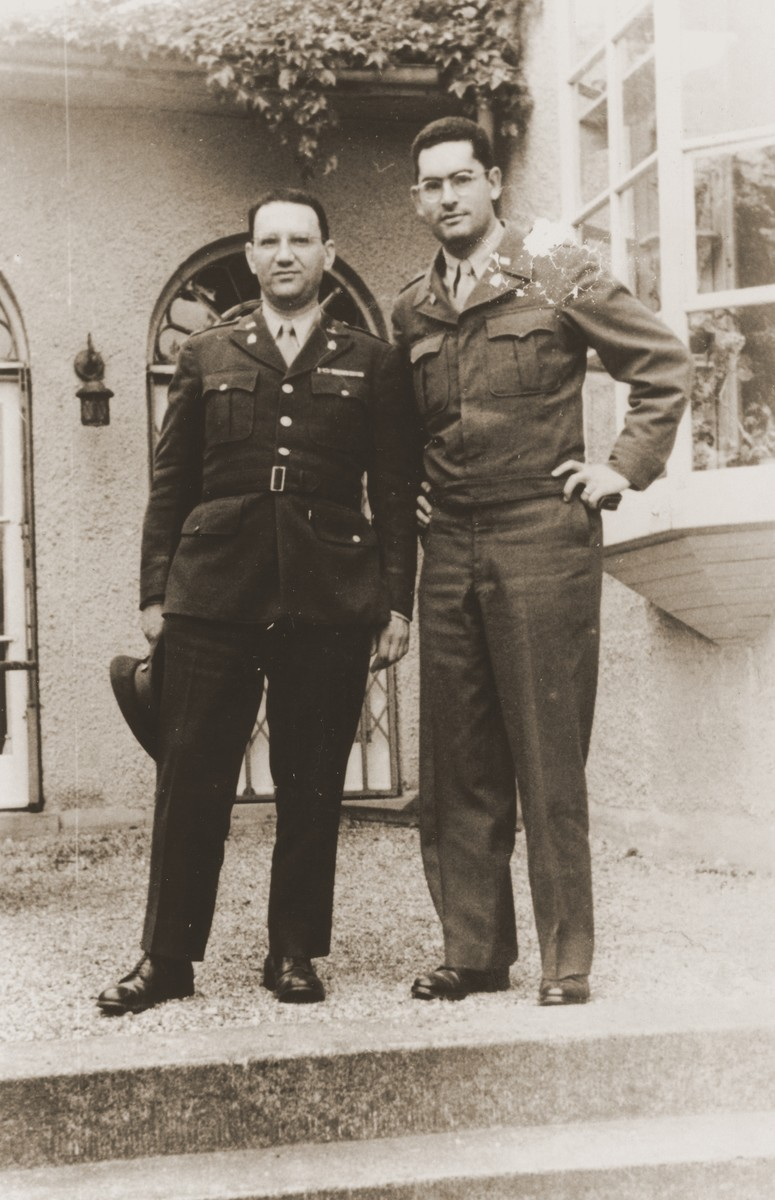 Chaplains Emanuel Rackman and Herbert Friedman pose in front of the United States Forces, European Theater headquarters.