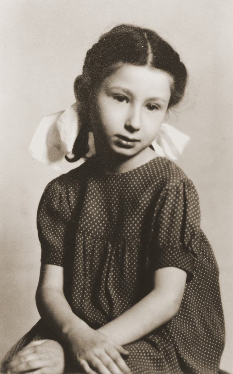 Portrait of Zofja Fajnsztejn, a Jewish child in hiding in Warsaw.  The picture was taken in the photo studio of her rescuer's cousin.