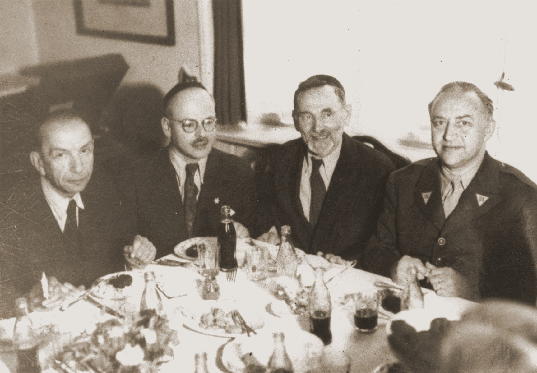 Rabbi Philip Bernstein (right), adviser on Jewish affairs to the U.S. Army commander in Europe, dines with local Jewish leaders in Berlin.  Also pictured is Erich Nelhaus (second from the left), head of the Berlin Jewish community.