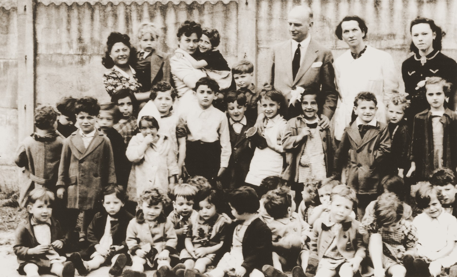 Group portrait of children and staff at the La Pouponniere children's home in Uccle.
