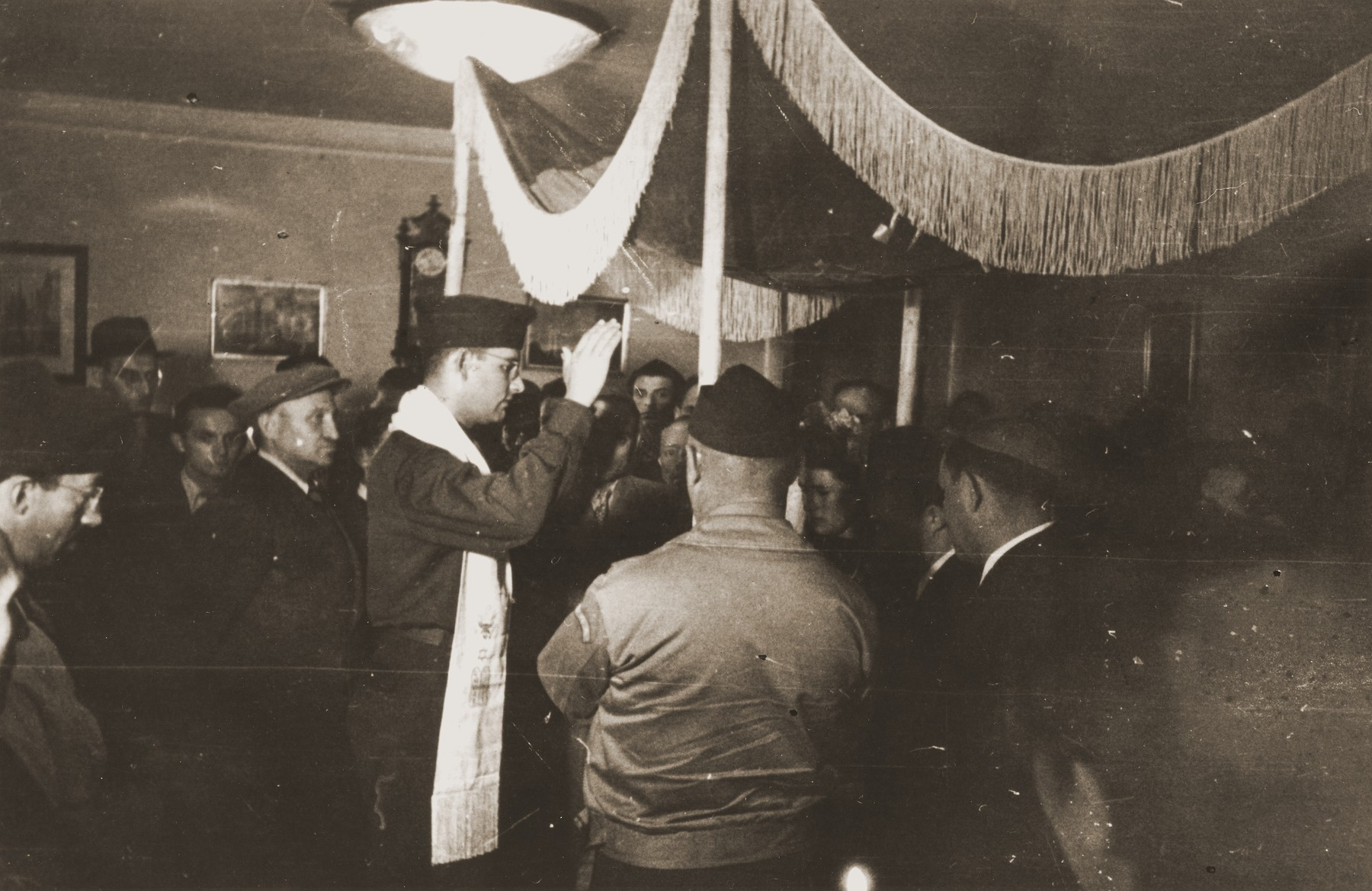 Rabbi Herbert Friedman blesses a bride and groom under a marriage canopy during a wedding at the Berlin chaplain's center.