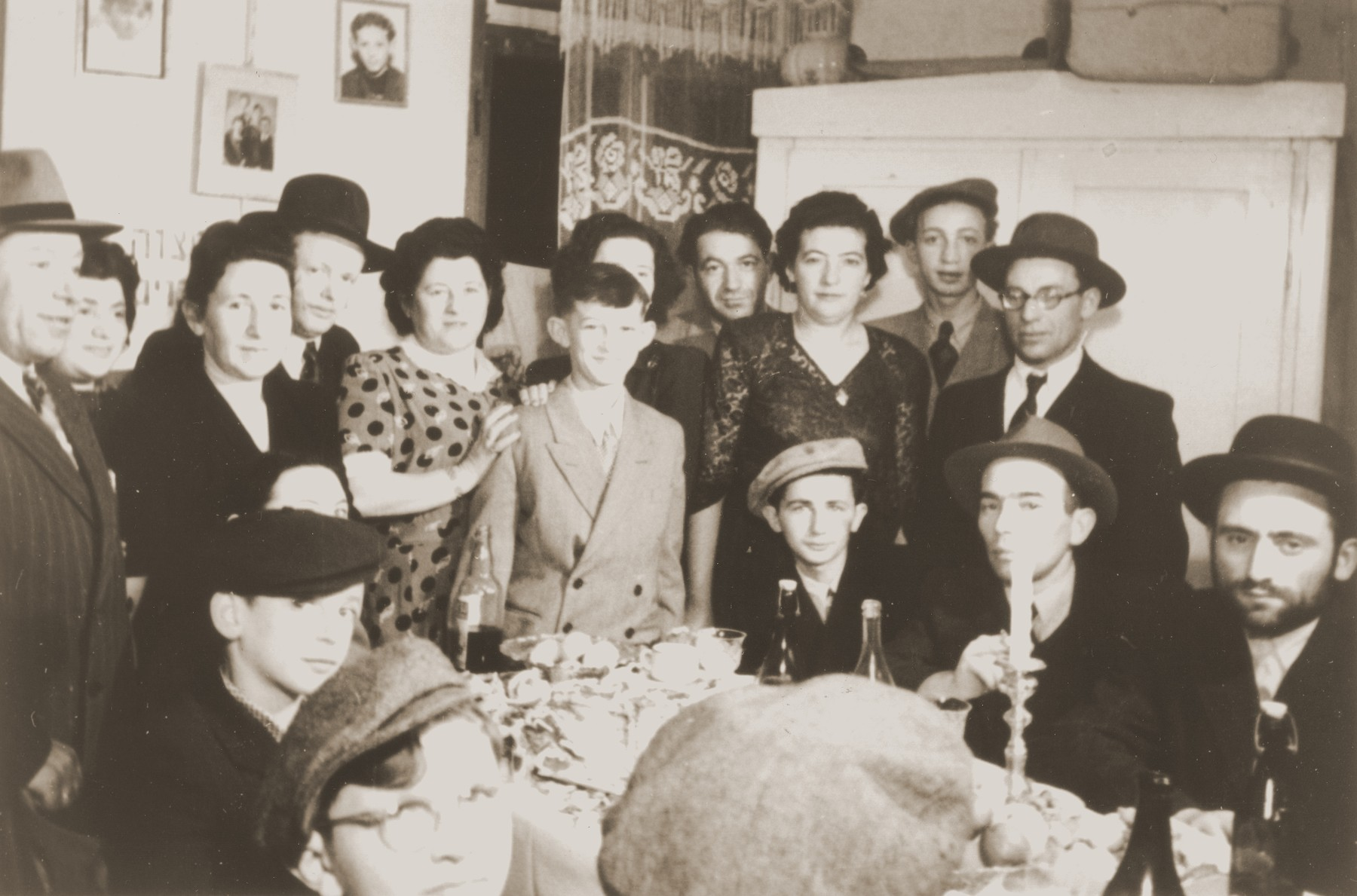 Motel (Mordechai) Appelbaum celebrates his Bar Mitzvah with family and friends in the Gabersee displaced persons camp.