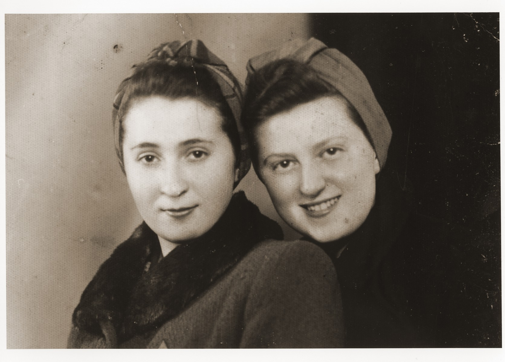Portrait of two young women in the Dabrowa ghetto.  Pictured on the right is Renia (Zylberszac) Nadel.