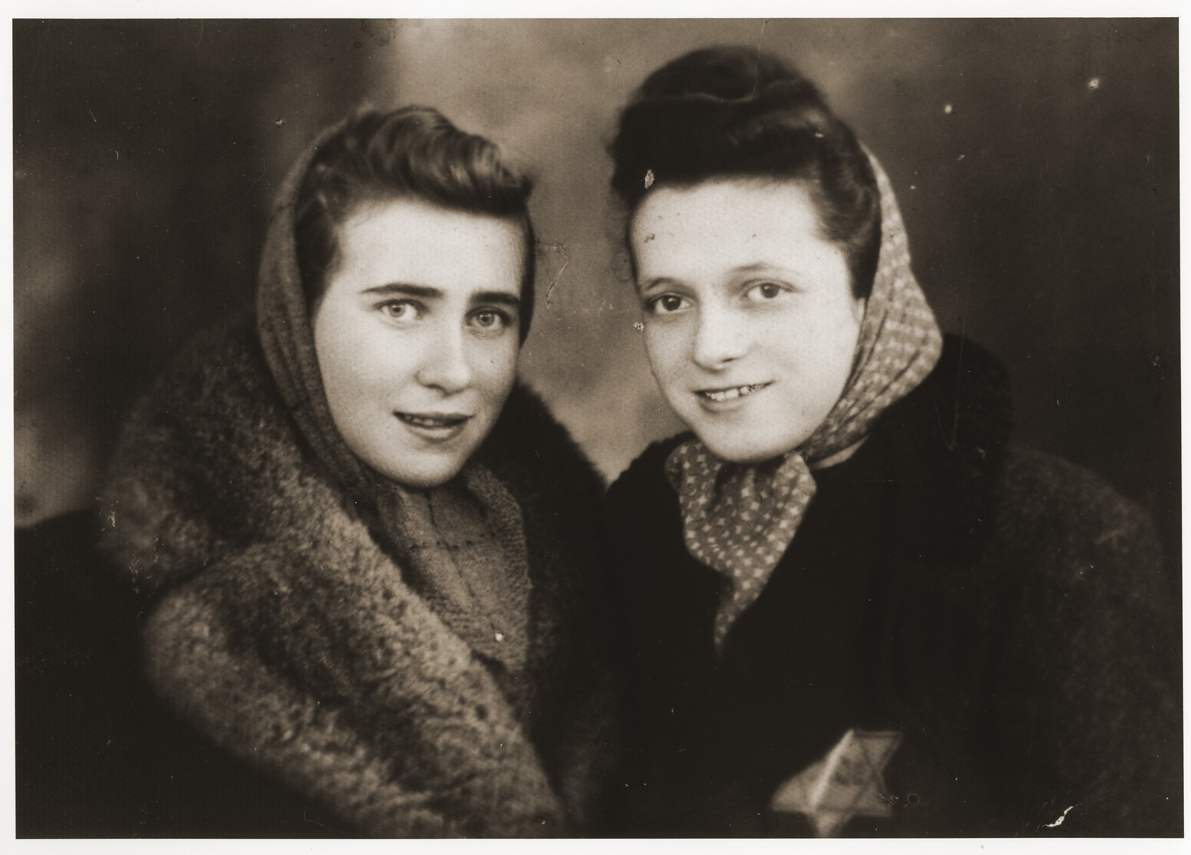 Portrait of two young women in the Dabrowa ghetto.  Pictured on the left is Ala Zylbersztajn.
