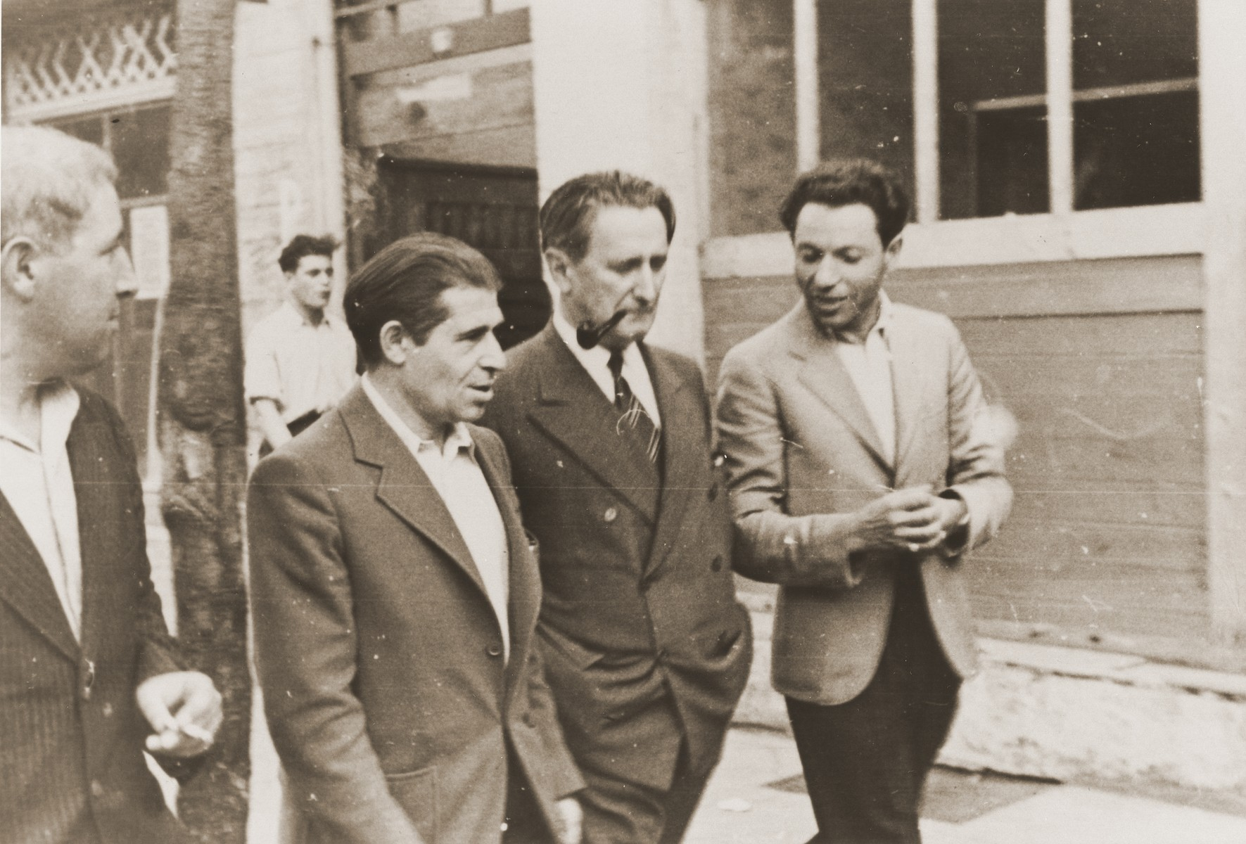 Nahum Goldmann, chairman of the executive council of the World Jewish Congress, is led on a tour of the Lampertheim displaced persons camp.  Meyer Brumberg is walking next to Goldmann on his left.