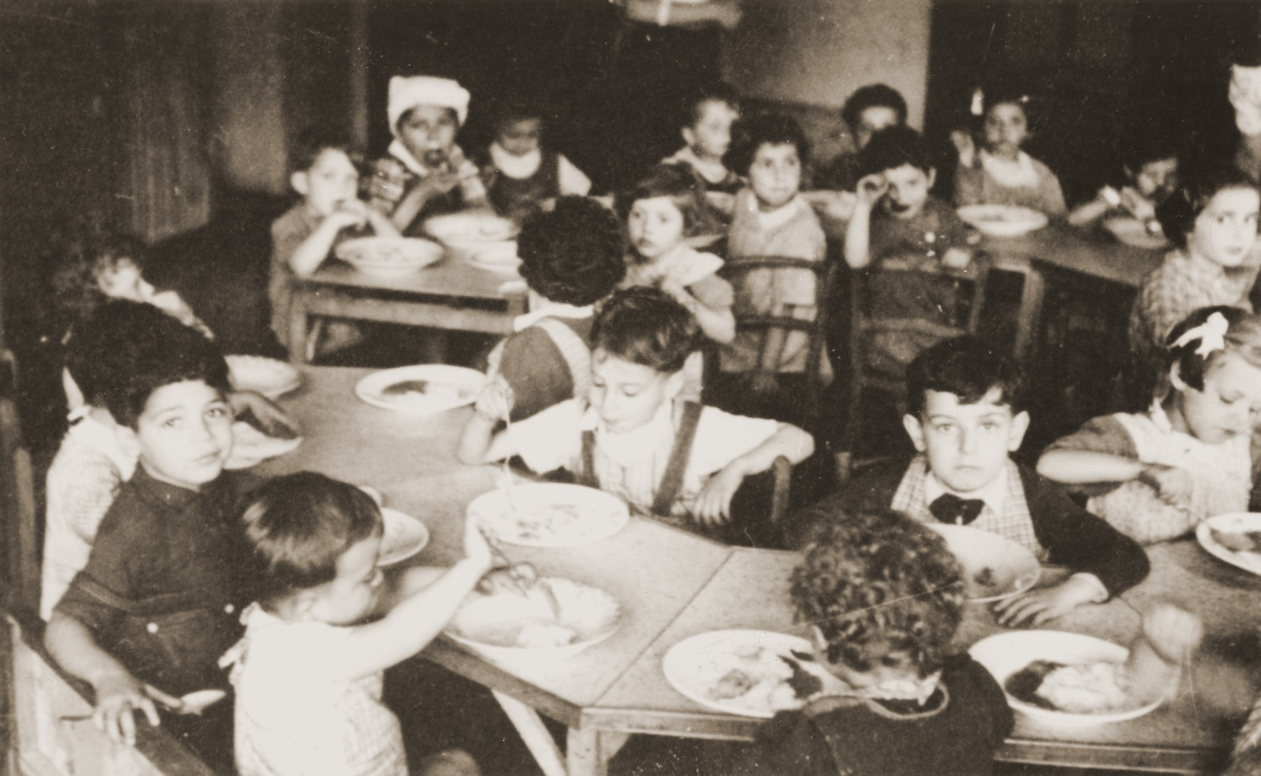 Toddlers at the La Pouponniere children's home in Belgium eat a meal in the dining room.