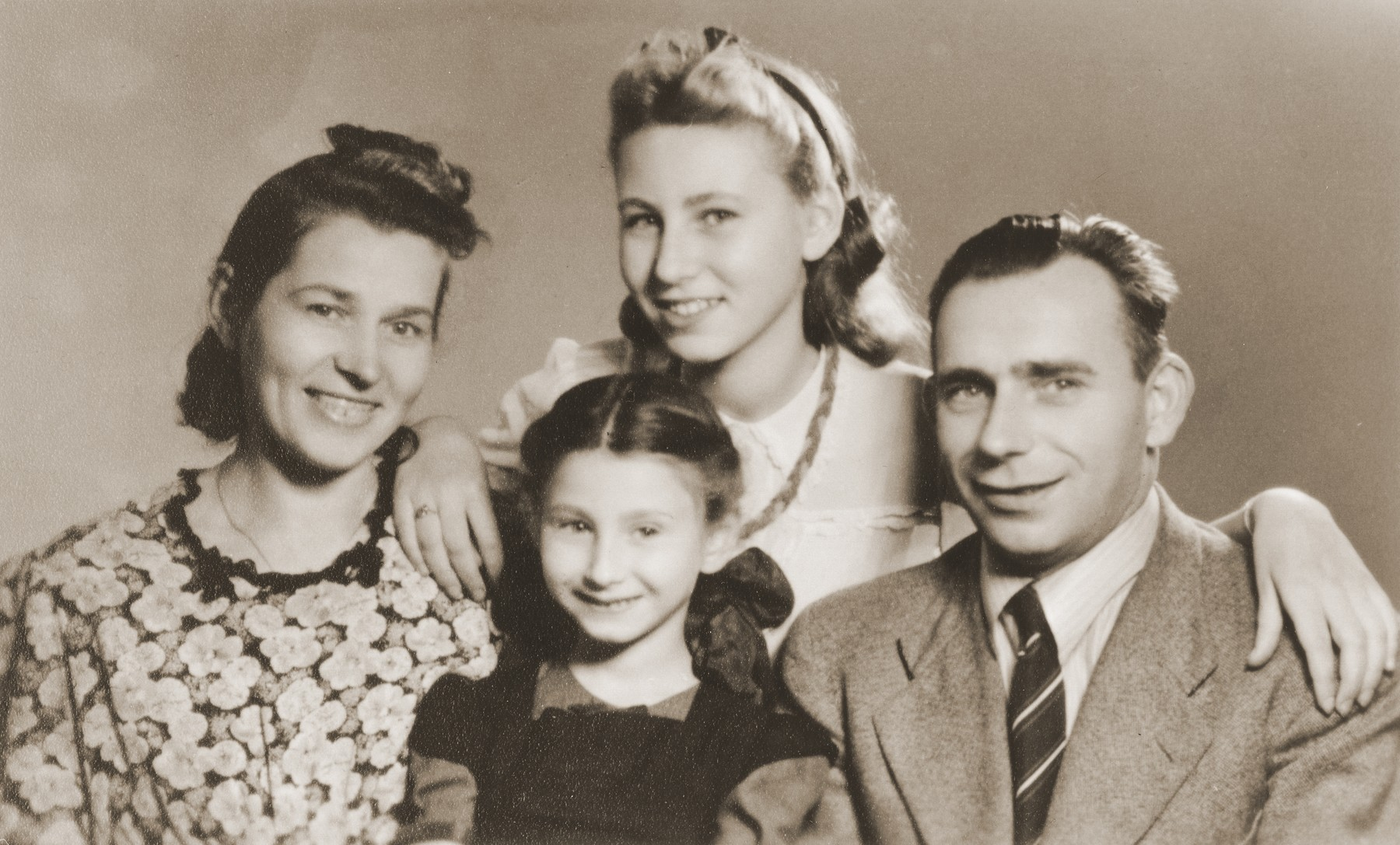 Alicja and Zofja Fajnsztejn, two Jewish sisters in hiding, pose with their rescuers, Helena and Josef Biczyk.    The picture was taken in the photo studio of the Biczyk's cousin.