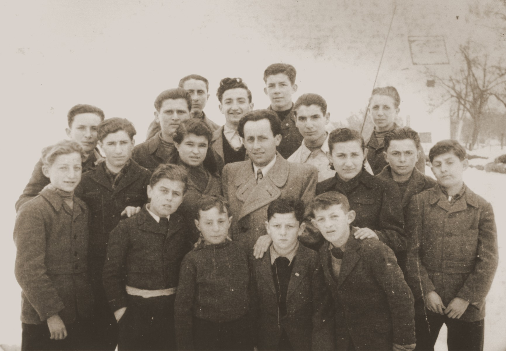 Group portrait of Jewish youth at the Tarbut school in the Gabersee displaced persons camp.  Among those pictured are Yitzhak Appelbaum (front row, left), Martin Thau (front row, third from the left), Henia Spielman (second row, third from the left),  Motel Appelbaum (front row, right), and Mania Kronisch (second row, third from right), and Munio Zeiger (back row, center).
