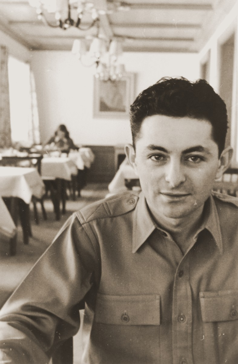Portrait of U.S. Army chaplain, Rabbi Abraham Klausner, in a dining room.