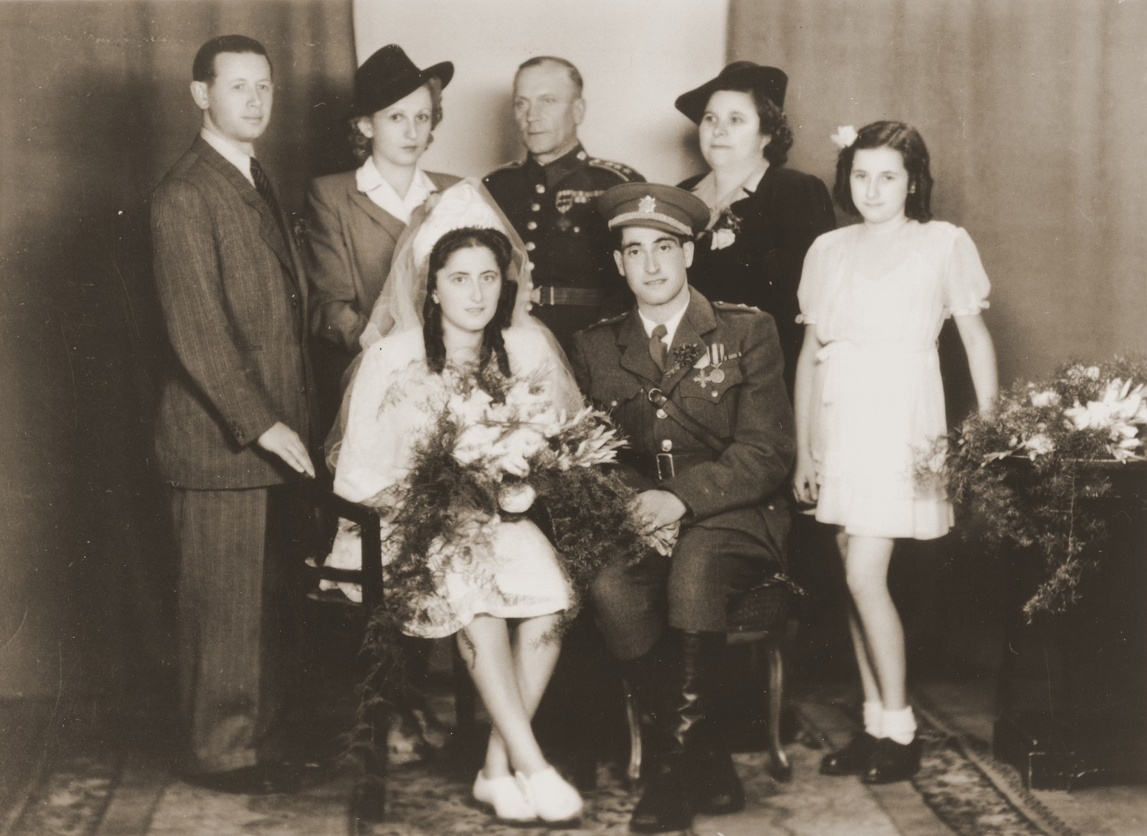Wedding portrait of Erika Neuman and Robert Kauder.  Standing from left to right are Eugene Novak, Beatrice Rada, the colonel of Robert's regiment, Malci Novak and Ruth Novak.
