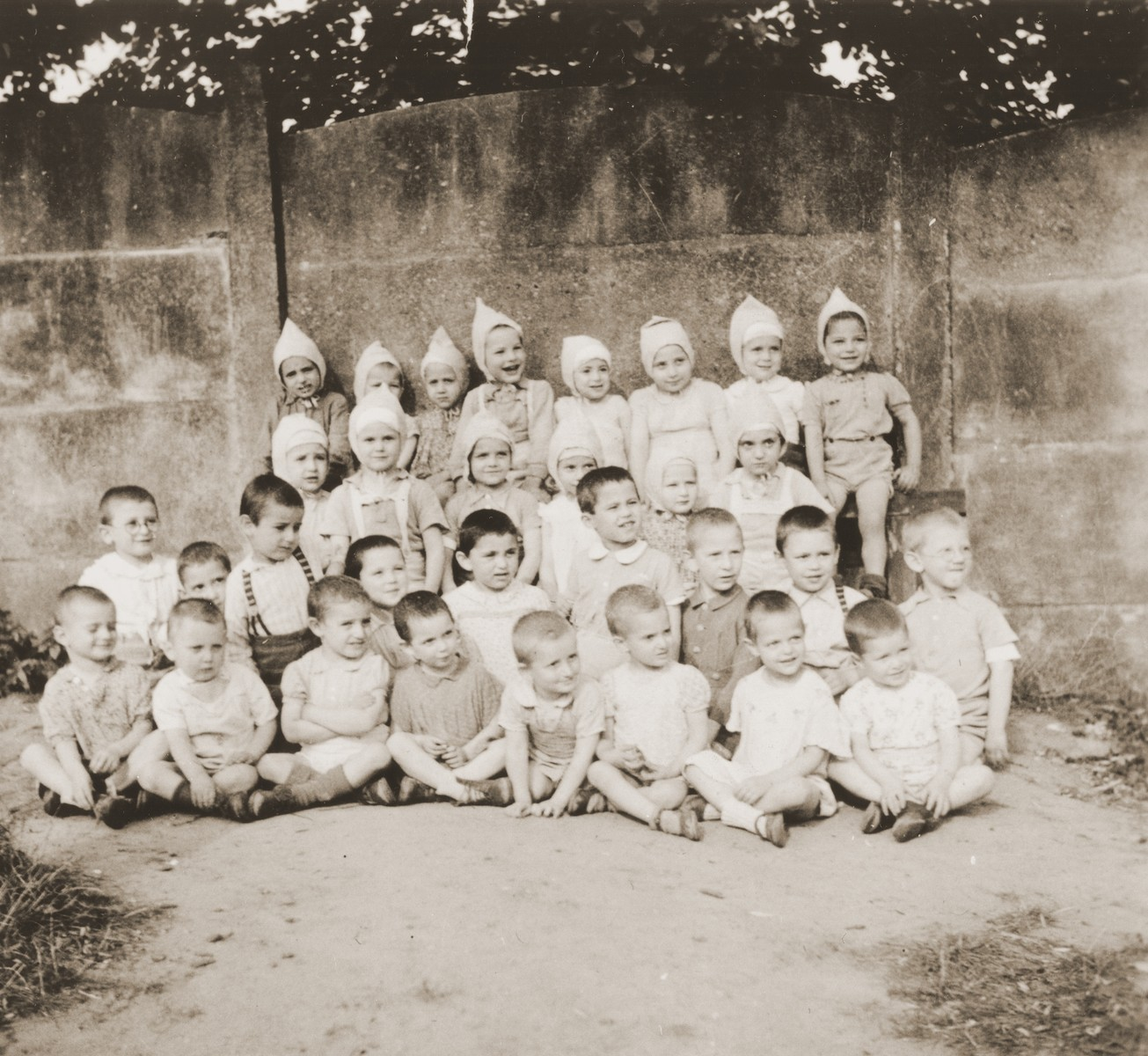 Group portrait of children at the La Pouponniere children's home in Belgium.