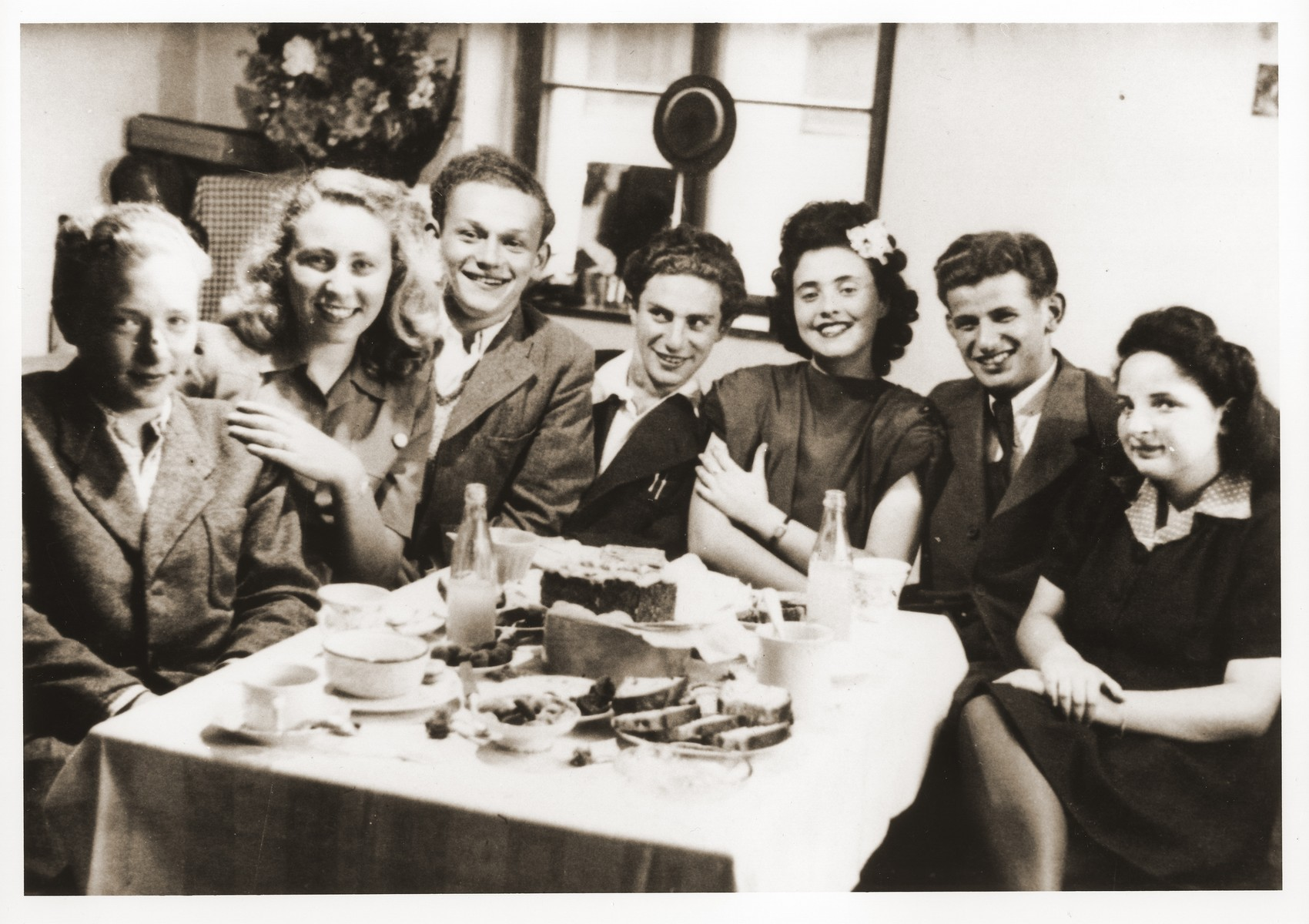 A group of young adults attends a birthday party for Irene (Freda) Landau in the Foehrenwald displaced persons camp.  Among those pictured is Frena Landau (third from the right), Otto Dornberg (second from the right), and Alicja Fajnsztejn (second from the left).  Also picutured is Bronik Grunschlag.