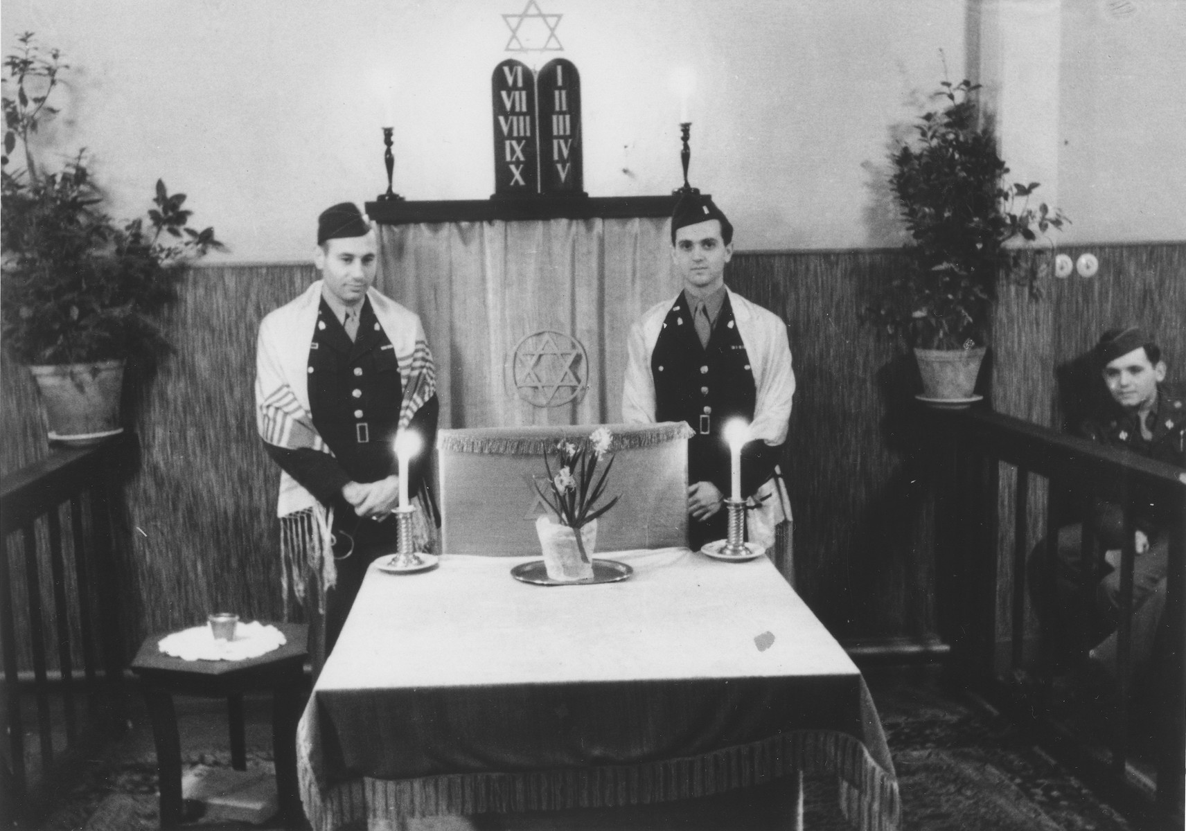 Outgoing chaplain, Rabbi Ernst Lorge (left) conducts Sabbath services with incoming chaplain, Rabbi Mayer Abramowitz in the chapel at U.S. Army Third Division headquarters in Bad Wildungen.