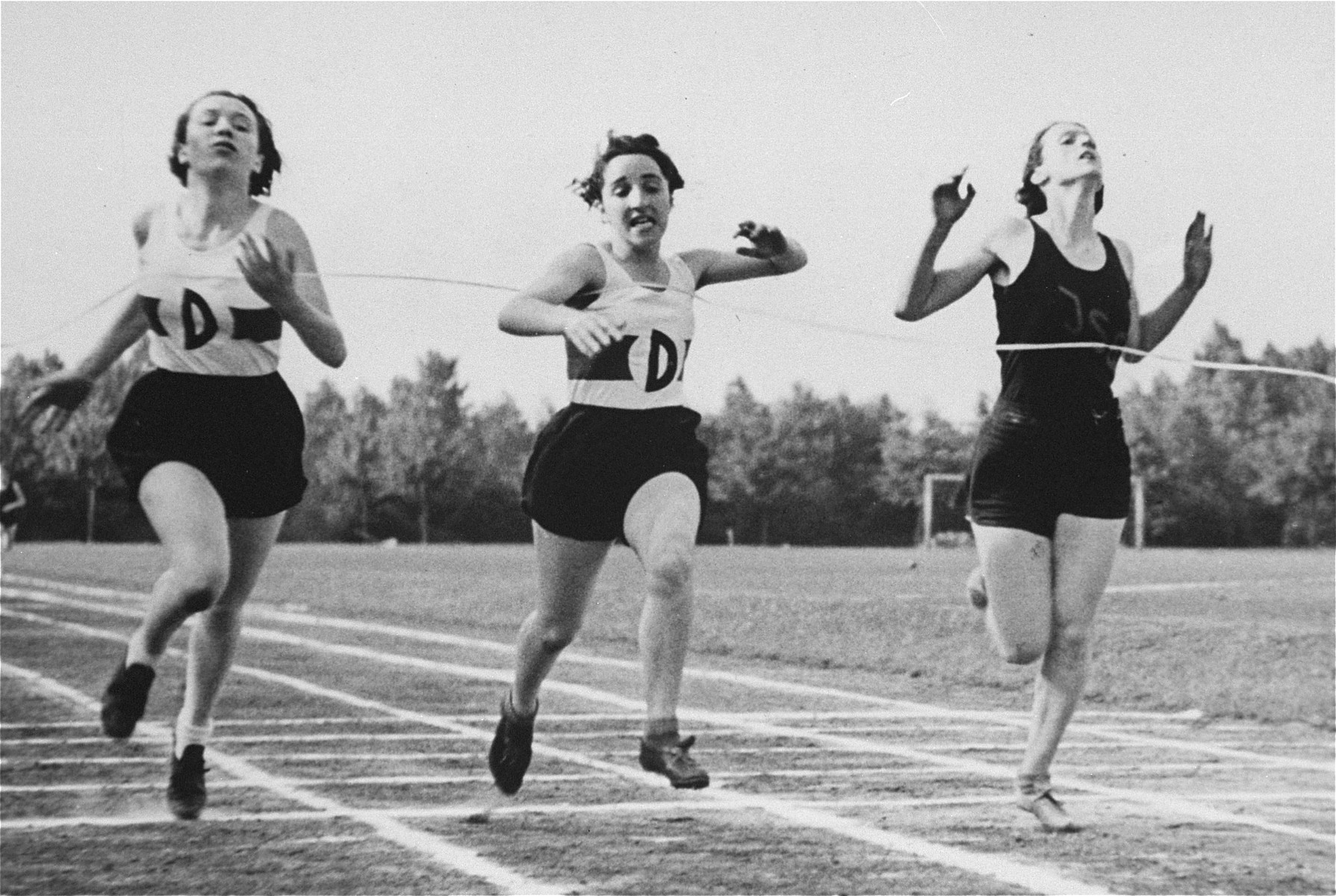 The donor, Ilse Dahl (left), competes against two other runners in the 100 meter race at a sporting event in Berlin.