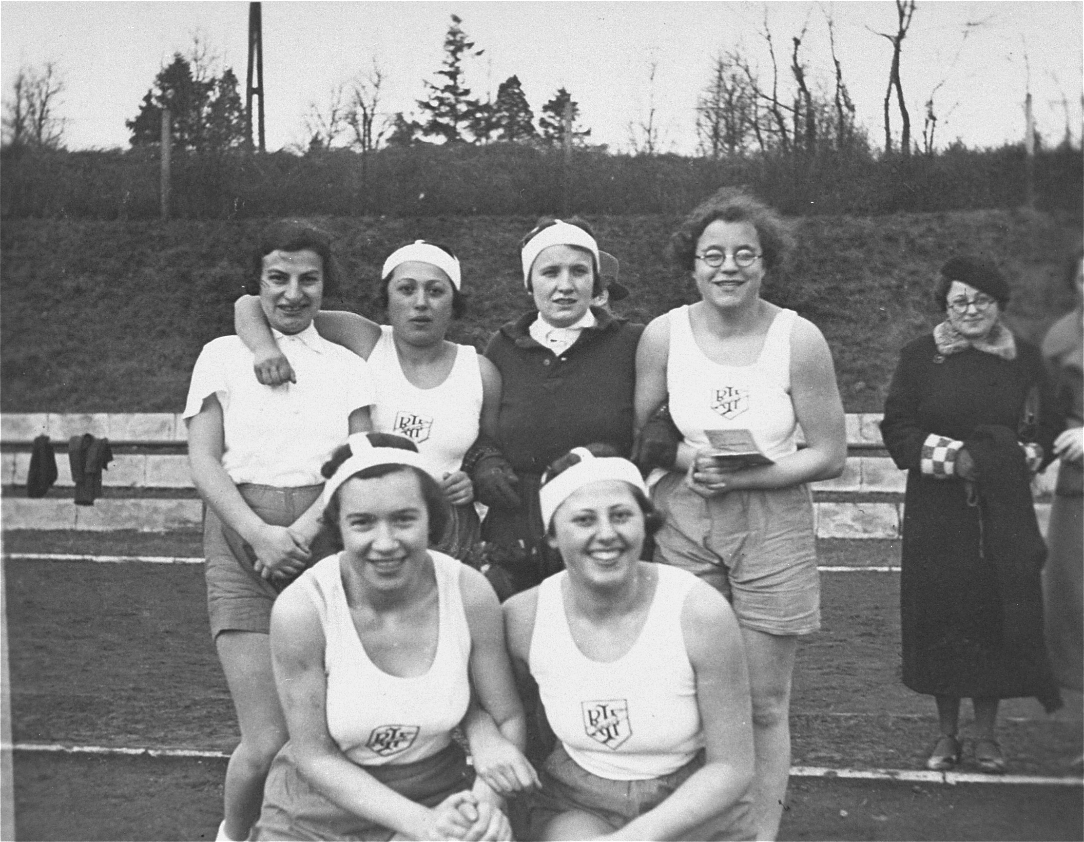 Group portrait of members of the women's handball team sponsored by the Reichsbund juedischer Frontsoldaten.    The donor, Ilse Dahl, is pictured in the front row, on the left.
