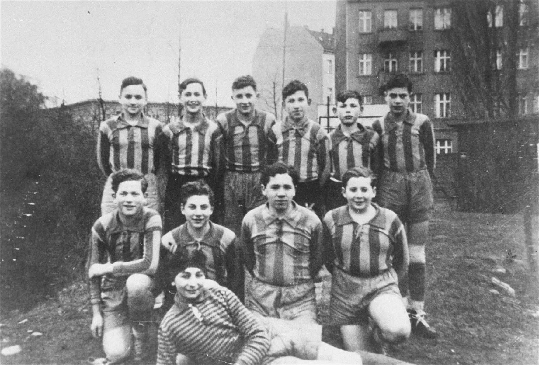 Group portrait of Jewish youth in a soccer team in Berlin.    Aron Sussmann (the captain) is standing third from the right,.