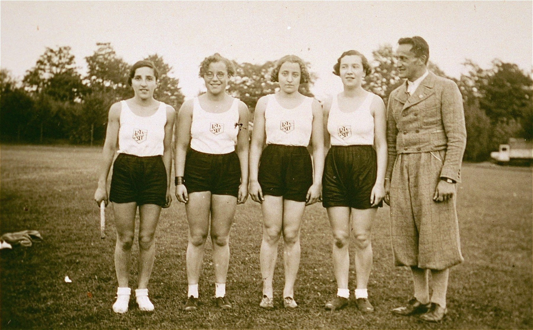 """Four members of the women's handball team sponsored by the  Reichsbund juedischer Frontsoldaten sports club at the West German Meisterschaft competition in Cologne.    Pictured (left to right) are Else Levy; Hedwig (""""Hete"""") Saul and her sister Liesel Saul, from Aachen; and the donor, Ilse Dahl.  Else Levy  survived the Holocaust and immigrated to England."""