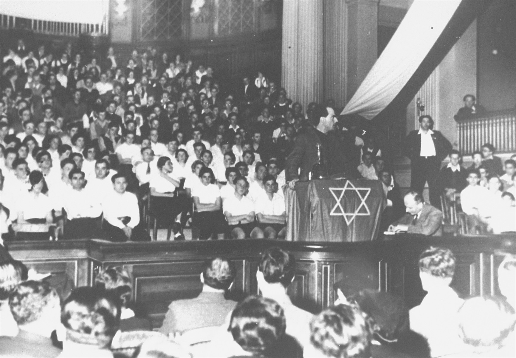 Yitzhak Ben Aharon, a labor leader from Palestine, addresses a meeting of German Jews in a synagogue in Berlin.