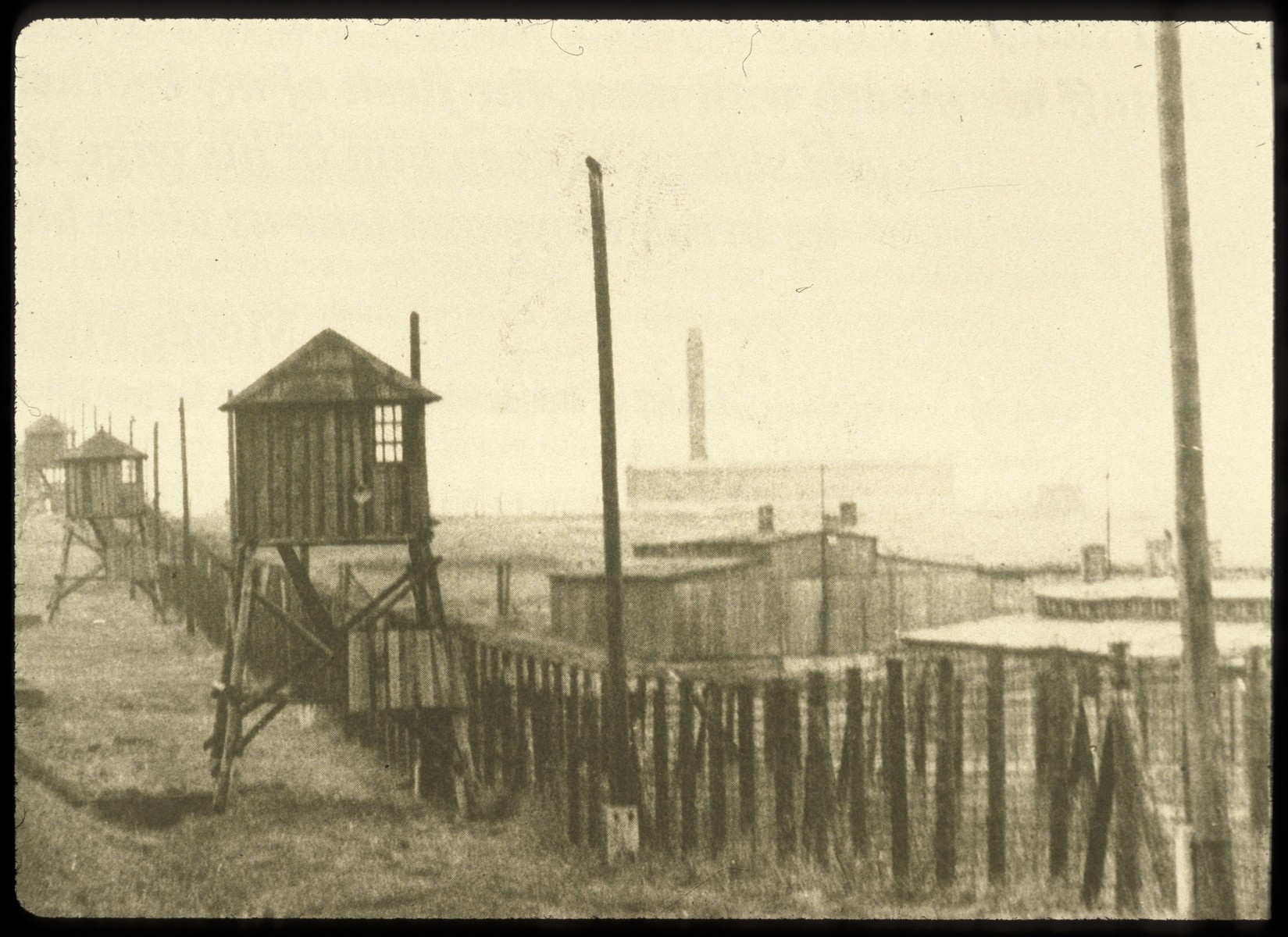 View of the watch towers and fence surrounding the Majdanek concentration camp.