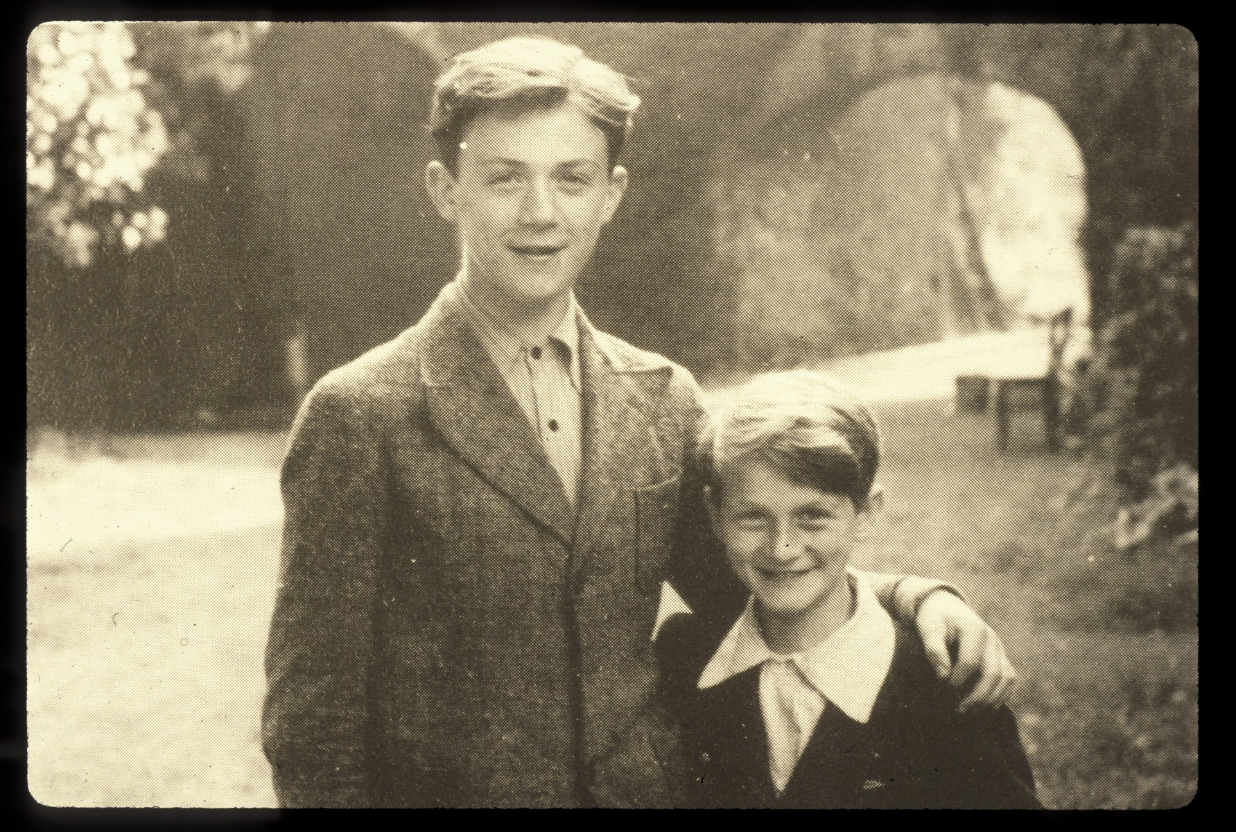 Portrait of two Jewish brothers who were saved by Father Bruno.  Pictured are Bernard and Charles Rotmil.  The photograph was taken by Father Bruno the day that the brothers arrived at Le Mont Cesar  in June 1943.