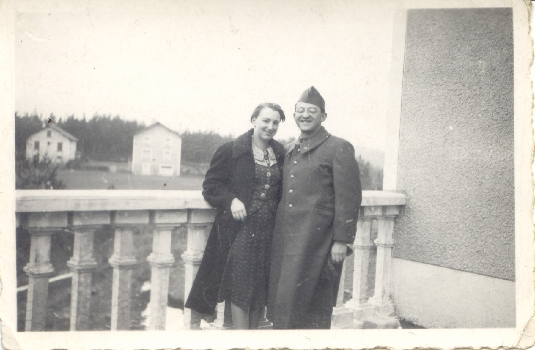 Rene and Germaine Brunschwig pose together on the balcony of a building in Le Chambon-sur-Lignon.