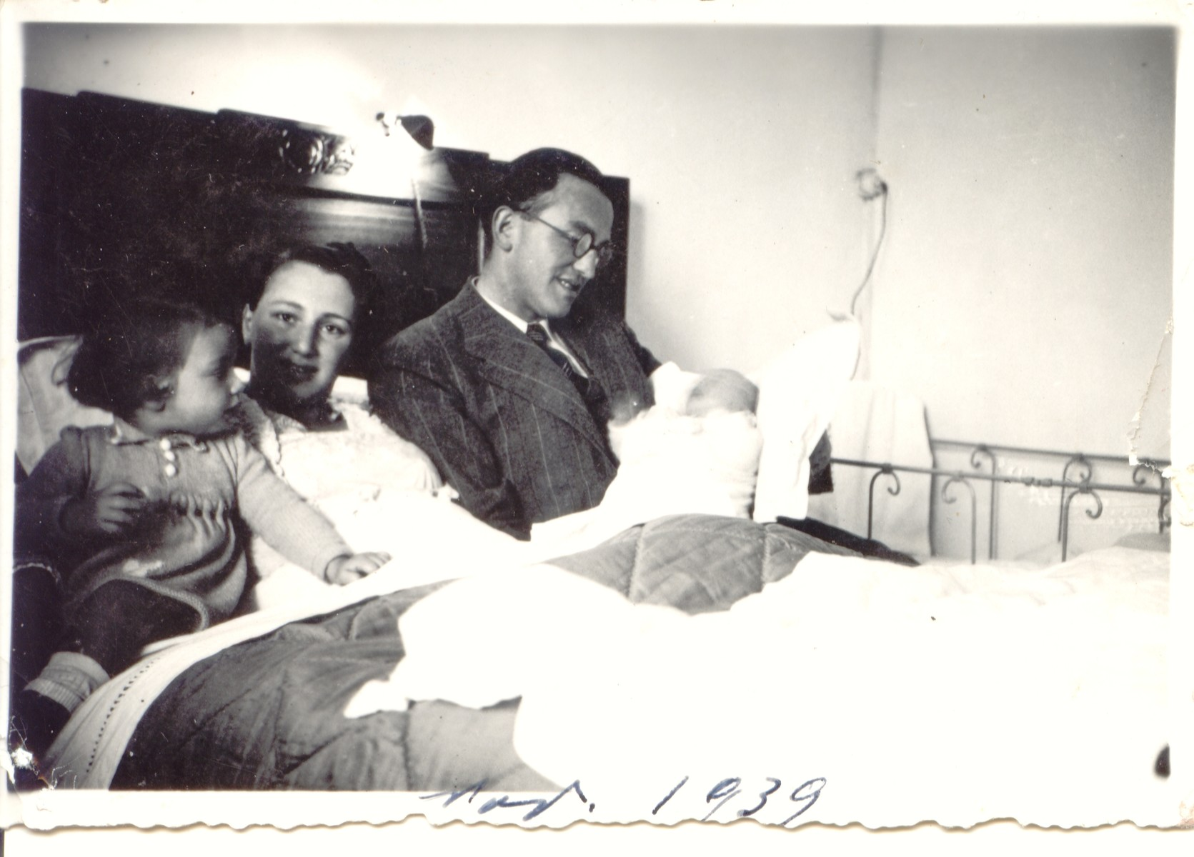 Two Jewish refugees from Alsace pose for a family portrait shortly after the birth of their second daughter.  Pictured are Rene and Germaine Brunschwig and their daughters Arlette and Sylvie.