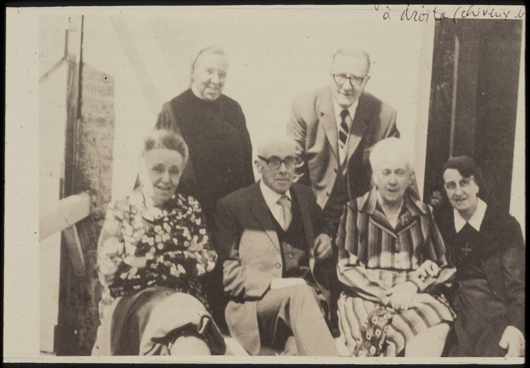 Father Bruno (Henri Reynders) poses for a group portrait with sisters and brother after the war.  Pictured are (seated, from left): Germaine, Father Bruno, Margurite, and Betsy;  (standing) Marie-Louise and Jean.