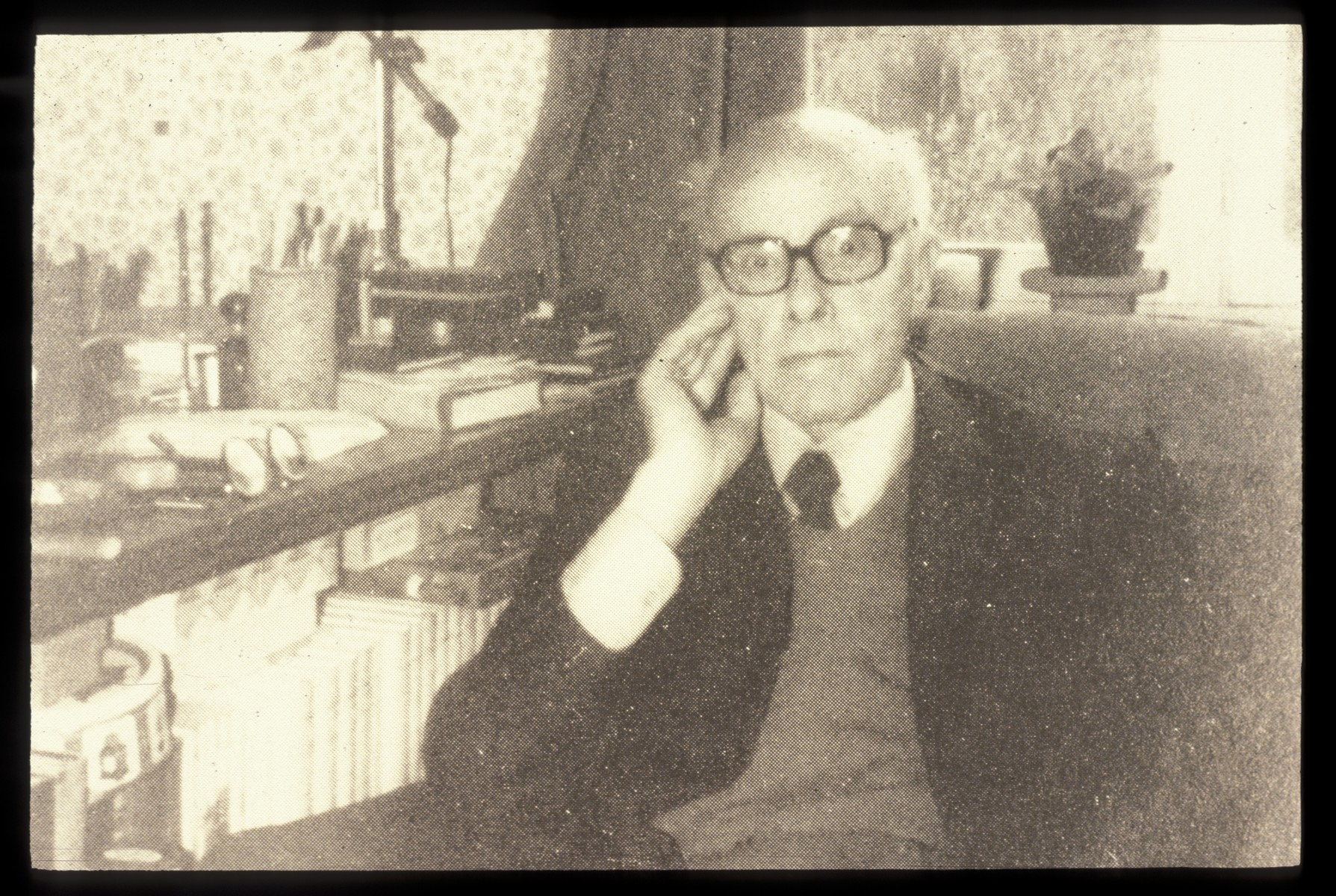 Close-up postwar portrait of Father Bruno (Henri Reynders) sitting in an armchair in a retirement home.