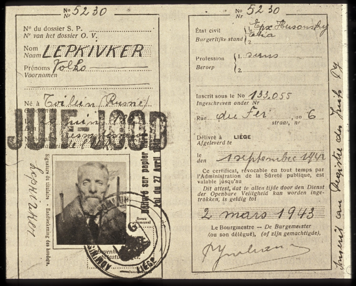 "Identification card issued to Rabbi Lepkivker, the chief rabbi of Liege, Belgium and stamped with the word ""Jew"" in two languages."