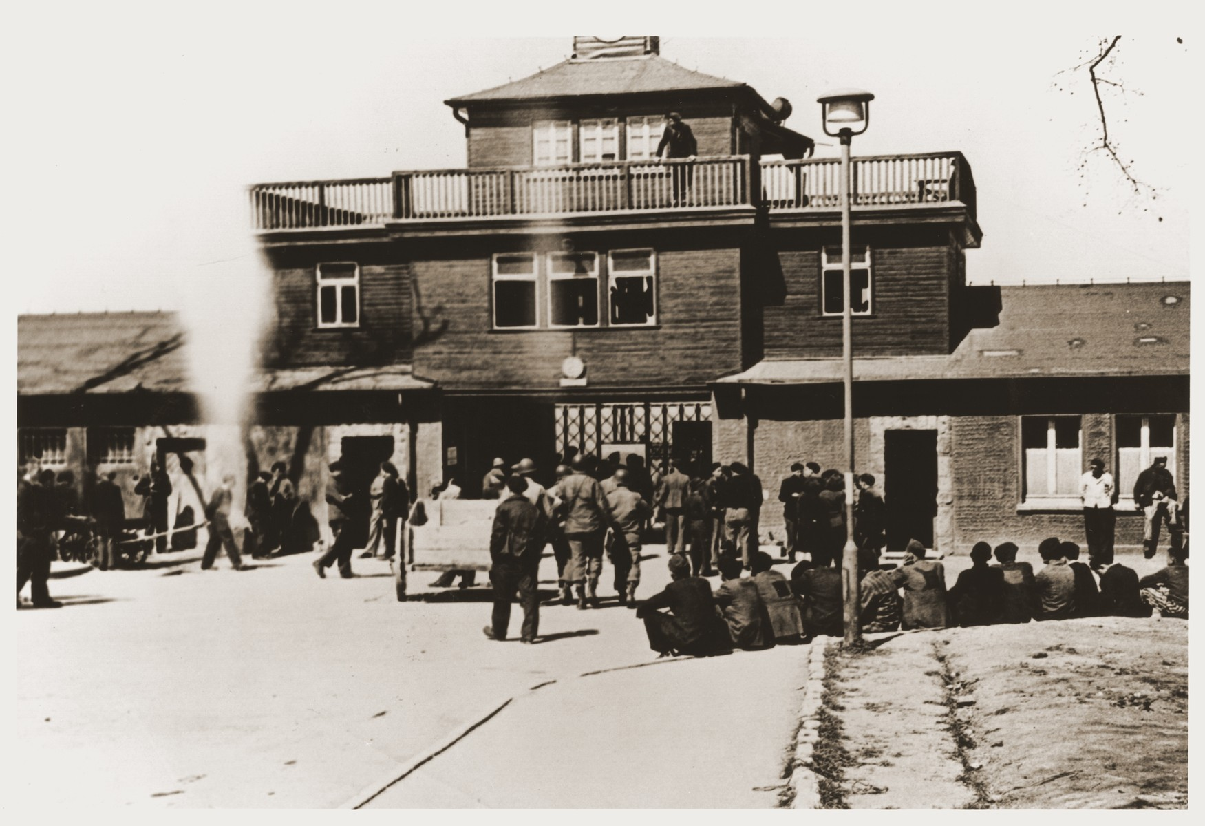 Visitors gather at the entrance to the Buchenwald concentration camp soon after liberation.