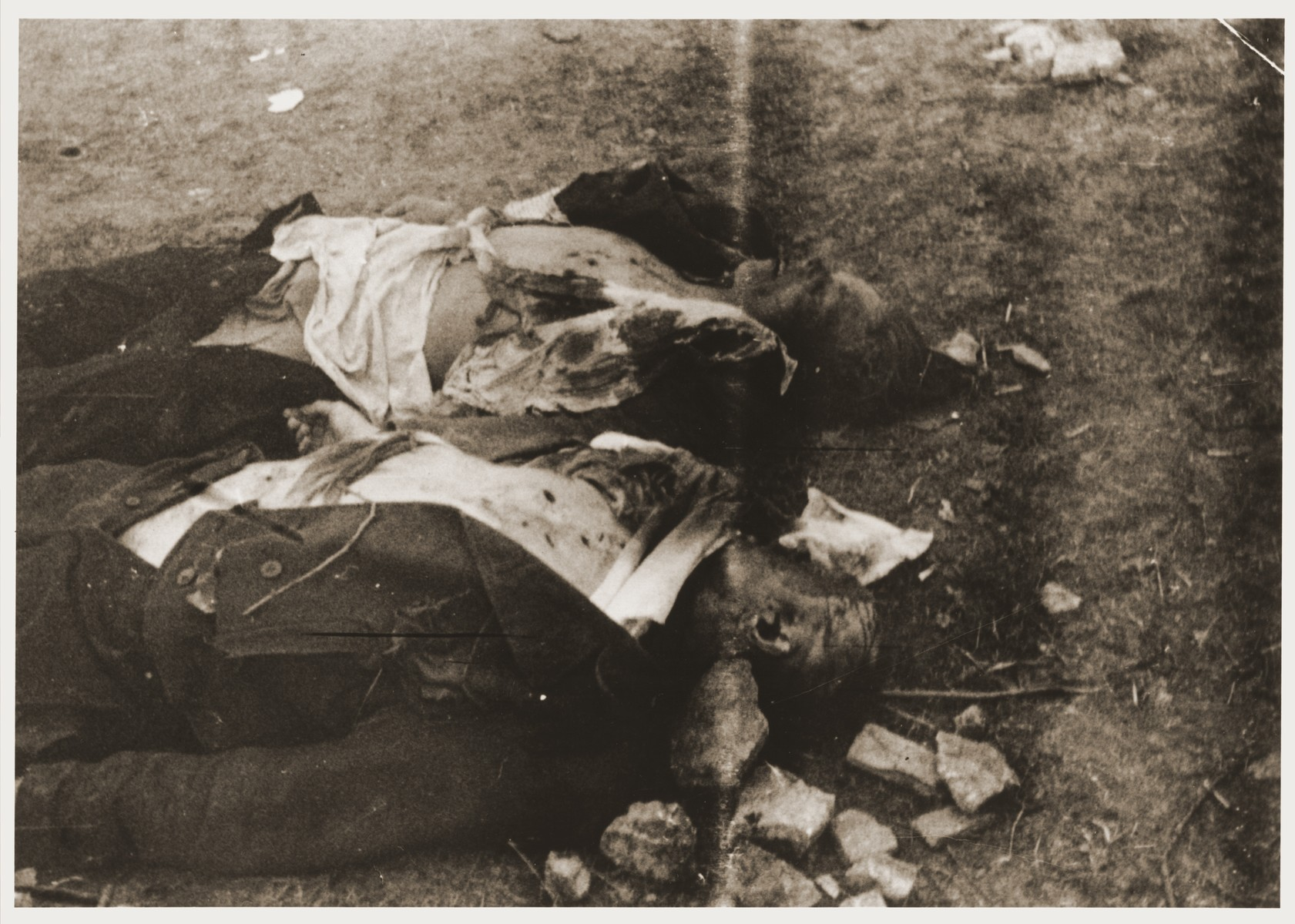 The corpses of two German guards killed by inmates during the liberation of Ohrdruf.    The photographer was an American soldier serving in the 69th Infantry Division, which participated in the liberation of Ohrdruf.