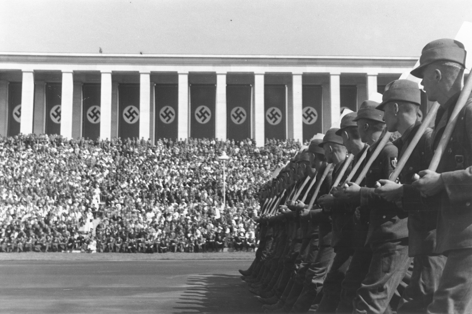A unit of the DAF (Deutsche Arbeitsfront, or German Labor Service) marches with shovels on the Zeppelinfeld during a rally at  the 1937 Reichsparteitag (Reich Party Day) in Nuremberg.
