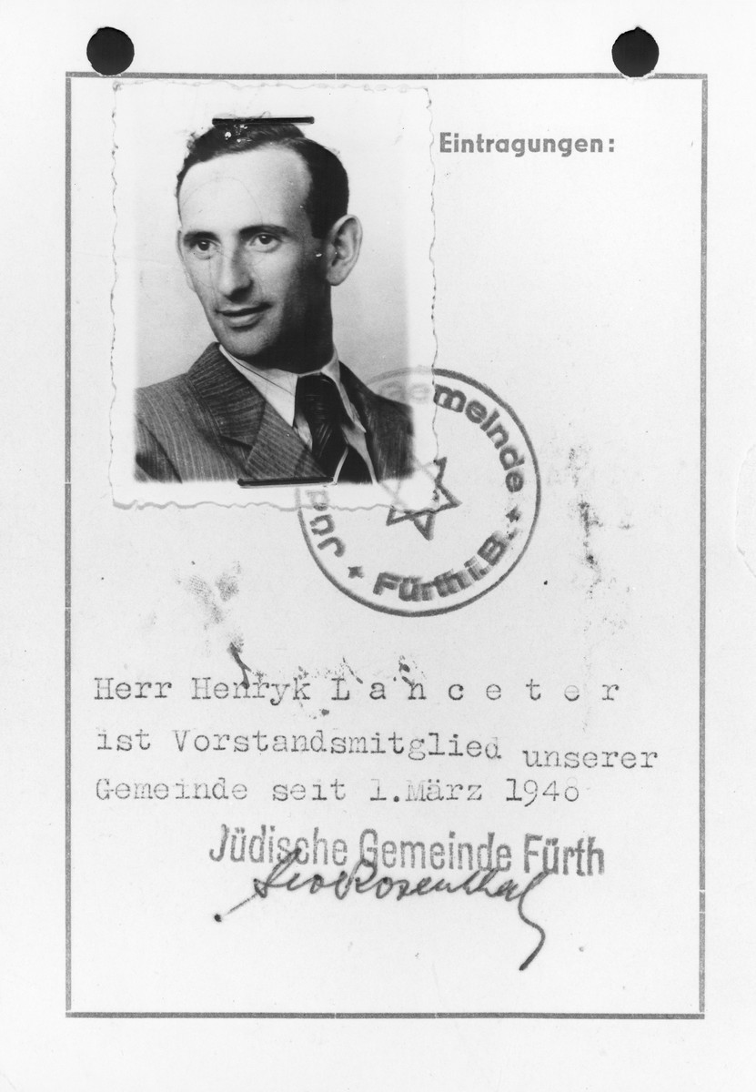 """Inside page of a membership card in the Jewish Community of Fuerth belonging to Henryk Lanceter that includes his photograph, the stamp of the community.  The German text reads: """"Mr. Henryk Lanceter has been a member of the executive committee of our community since March 1, 1946."""""""
