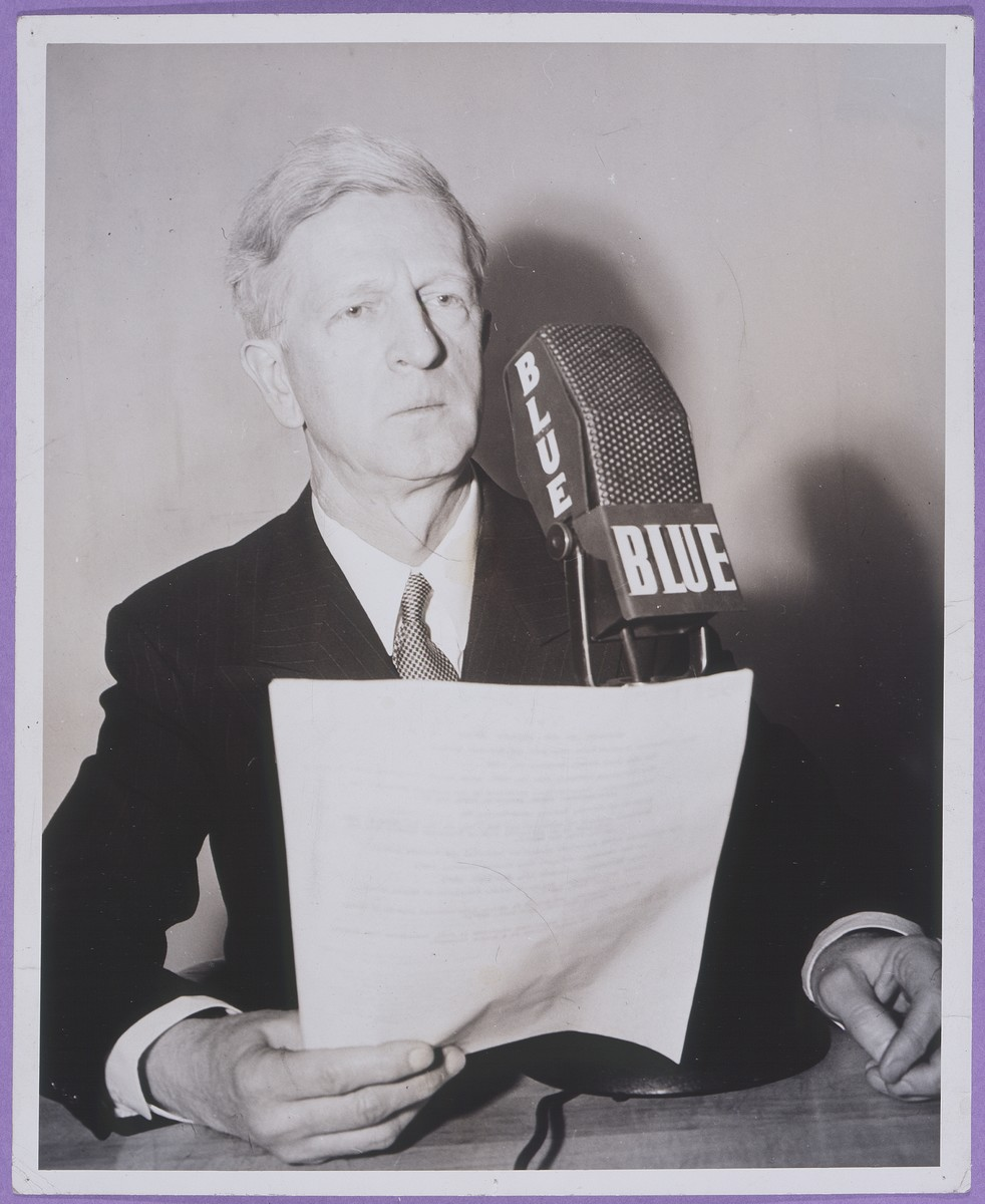 James G. McDonald delivers a radio broadcast as a new analyst for the NBC Blue Network.