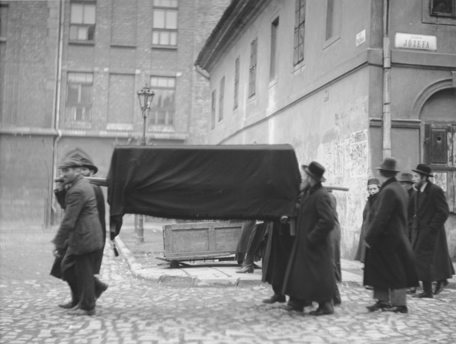Religious Jews carry a coffin along Jozefa Street in Krakow during a funeral procession.