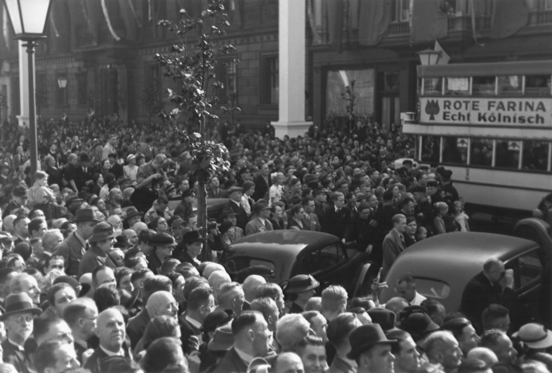 A large crowd of Germans fills the streets of Cologne during a Nazi rally.